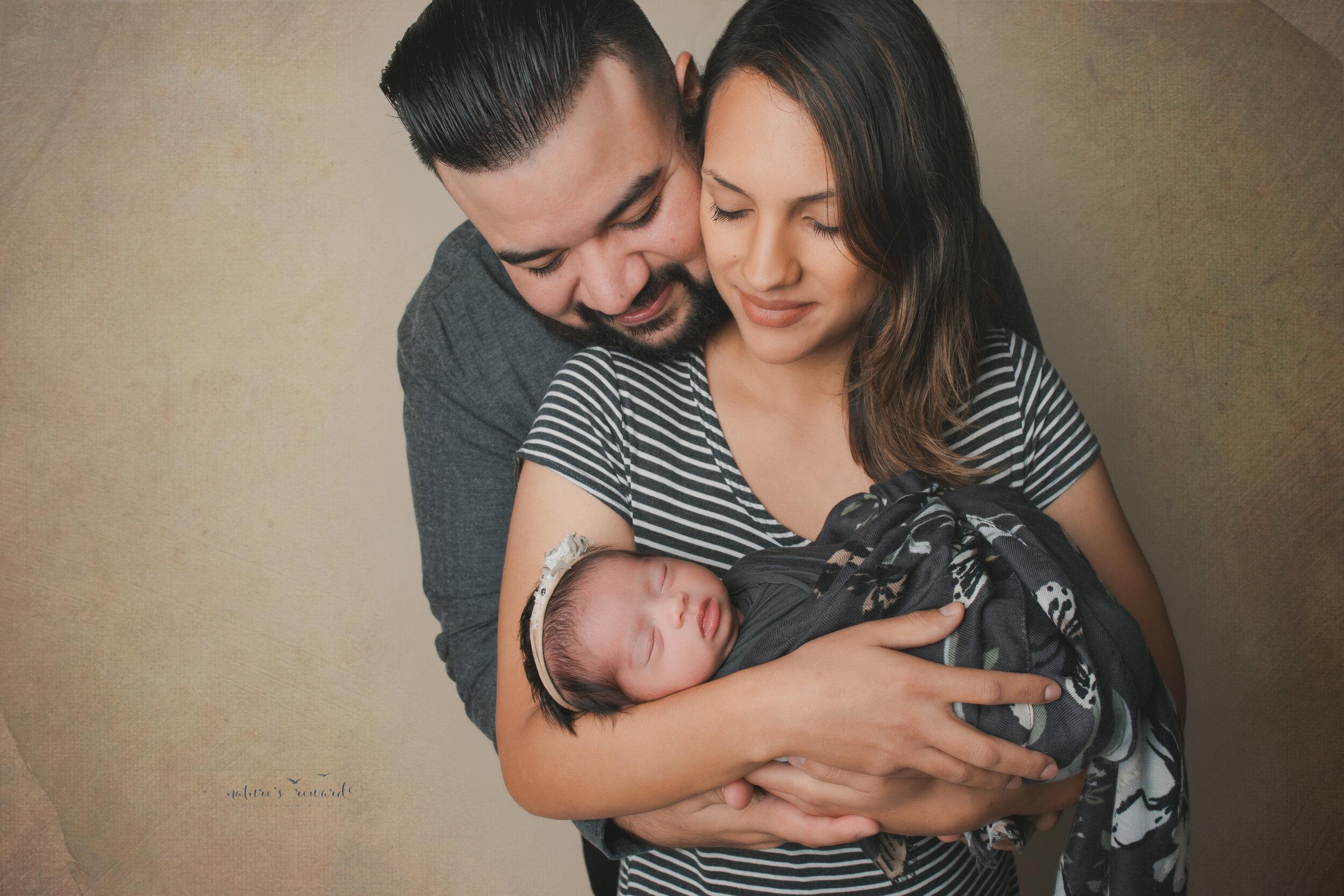 Cuddle us a family portrait, a newborn portrait by Nature's Reward Photography