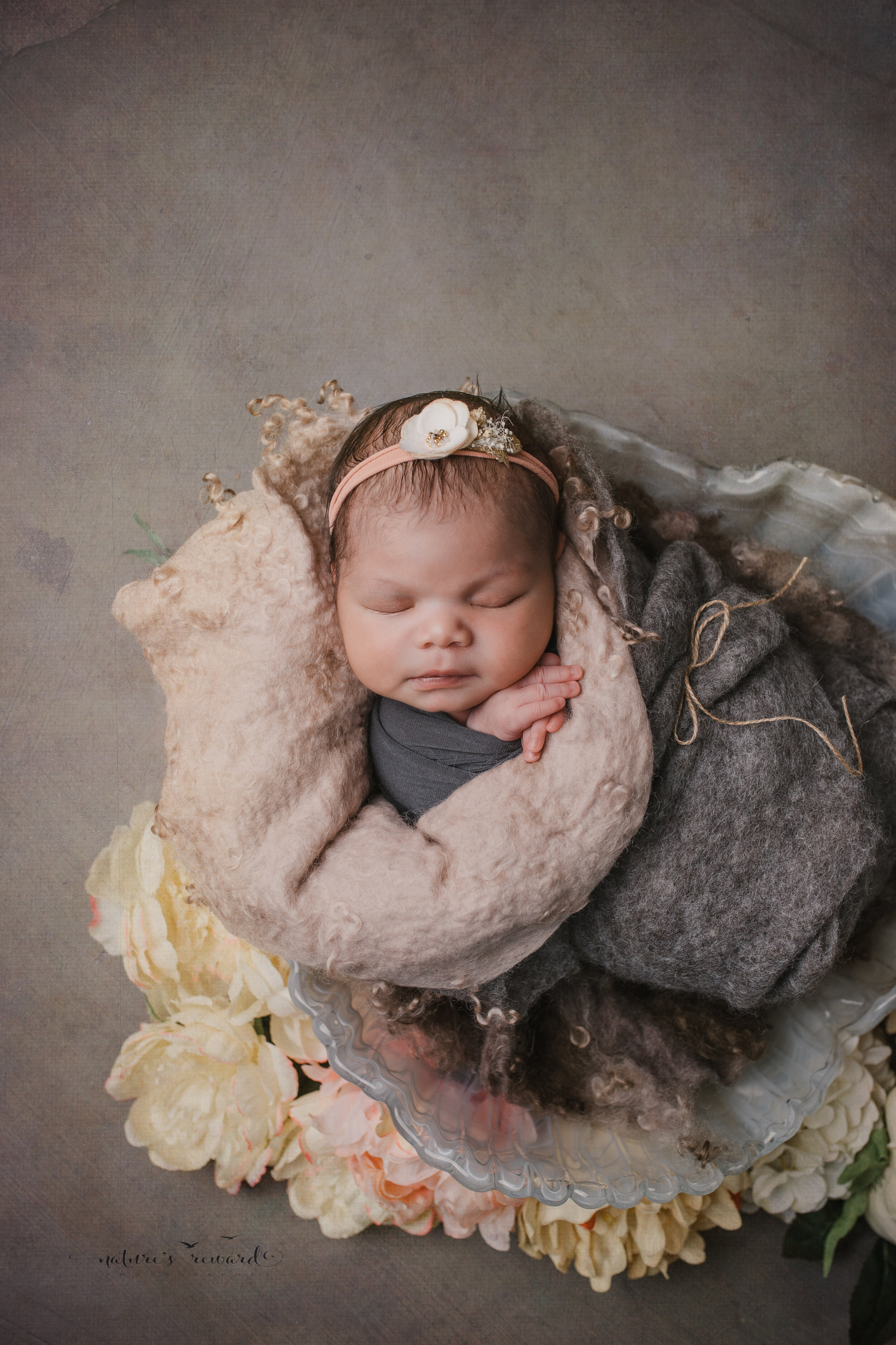 Newborn Baby girl swaddled in natural neutrals a portrait by Nature's Reward Photography