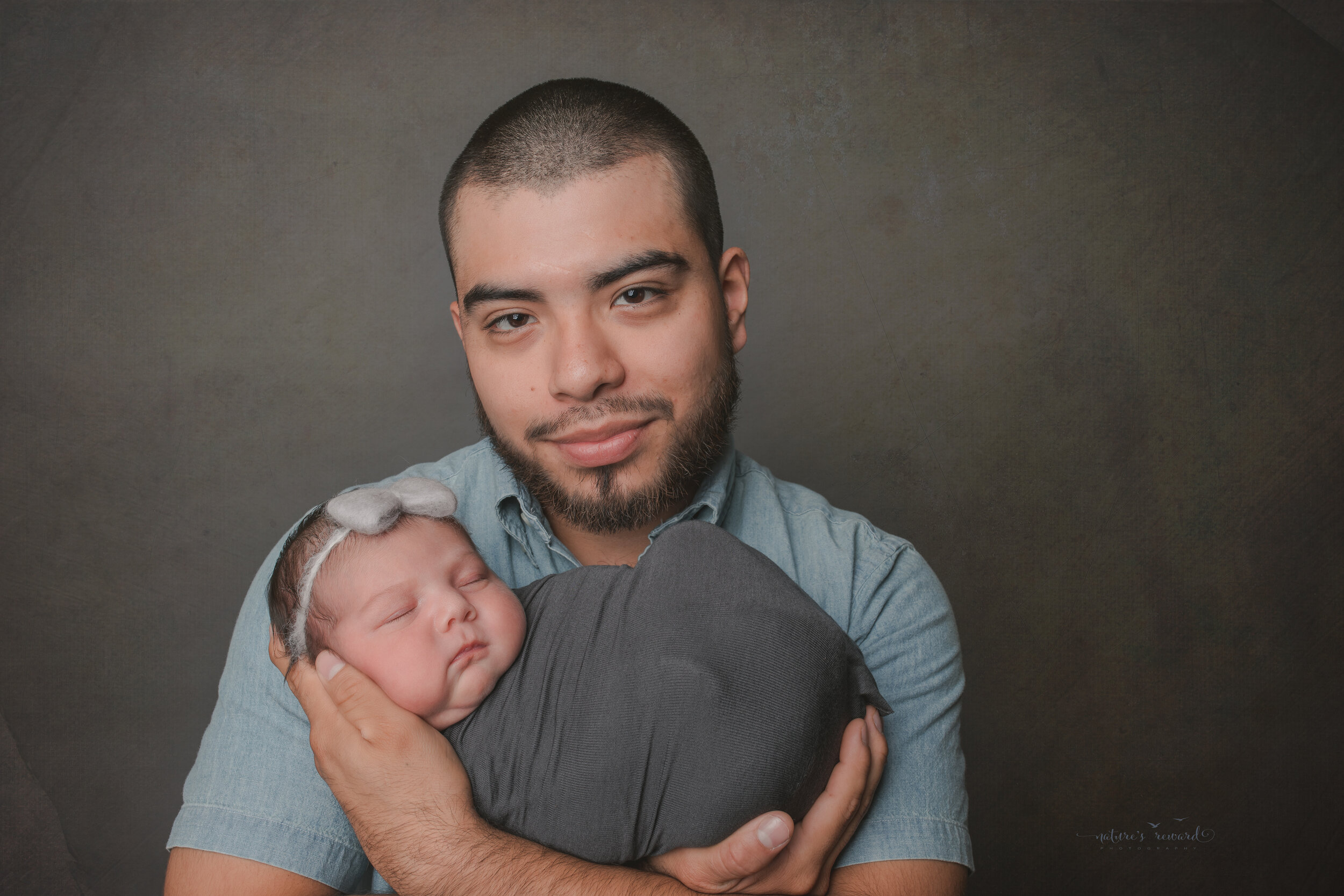 With dad, a newborn Portrait by Nature's Reward Photography
