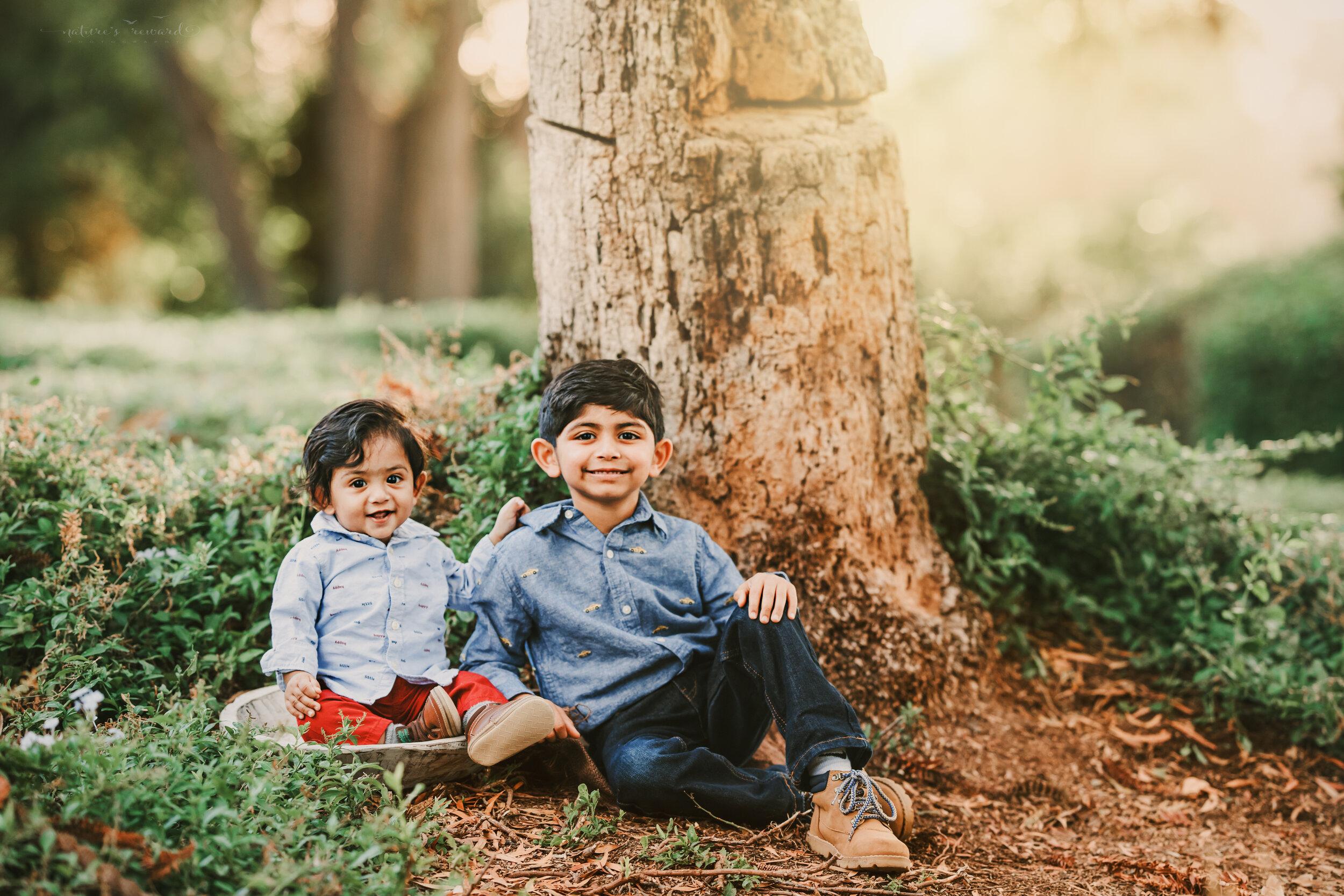 Fall sibling portrait in a lush green park in redlands California, by San Bernardino photographer, Nature's Reward Photography.