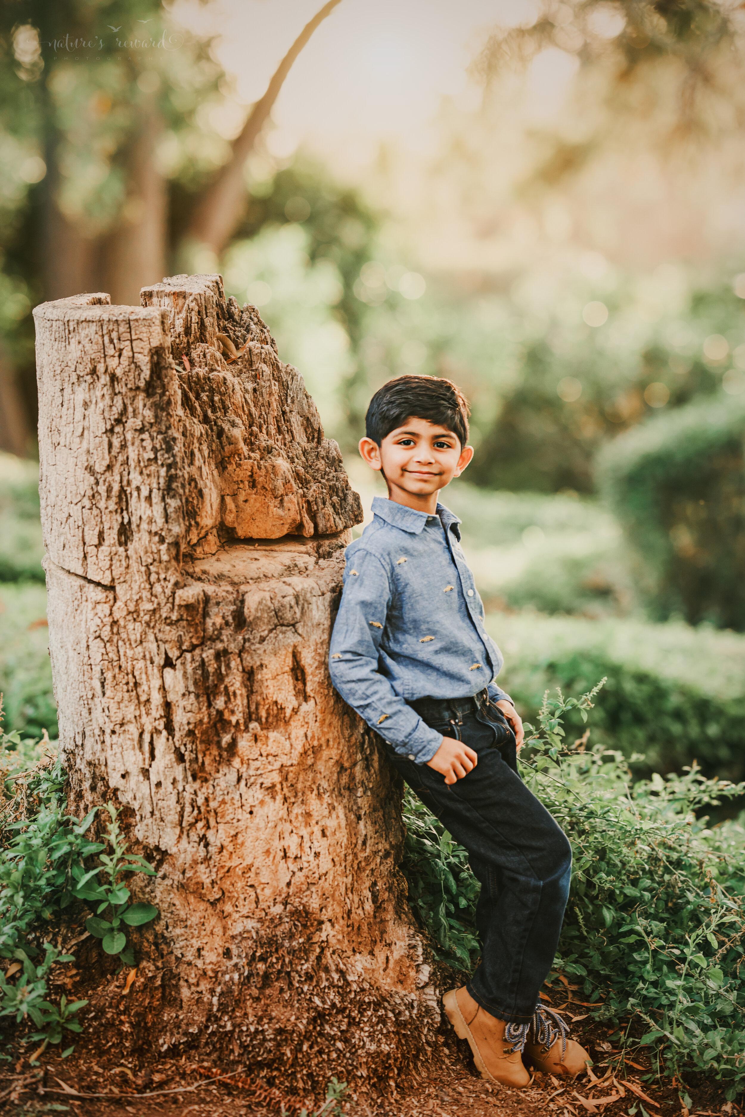 Fall child's portrait in a lush green park in redlands California, by San Bernardino photographer, Nature's Reward Photography.