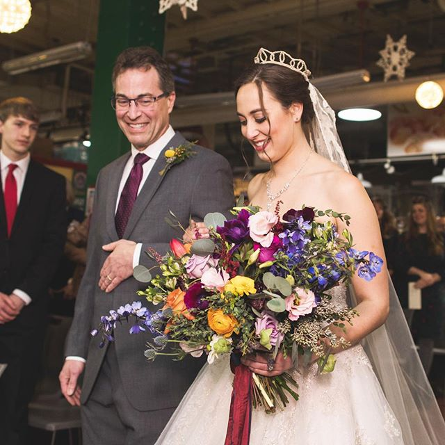 Stephanie and Rob's wedding was at the ReadingTerminal Market and it was such a festive and fun atmosphere! I love this shot of Steph and her dad❤️ She was stunning!  Photo credits: @shannoncollinsphoto  #phillybride #weddingflowers #bridalbouquet #colorfulwedding  #flowers #floraldesign #festivewedding