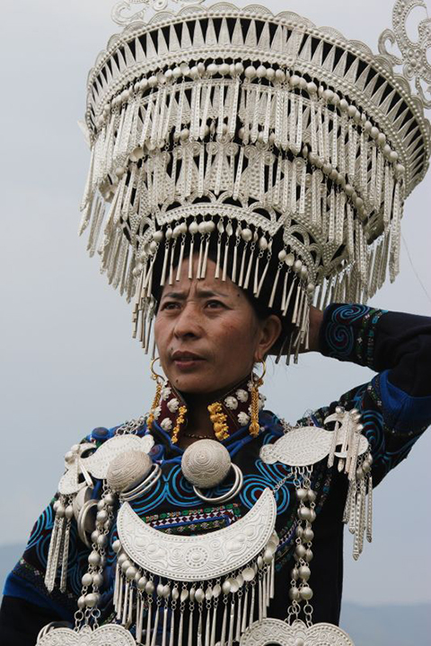 Participant at the Yi Torch Festival in Butuo Sichuan Province China