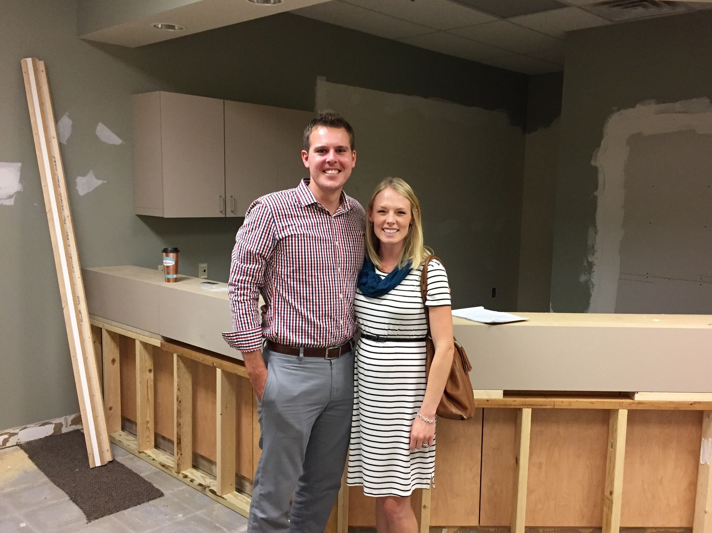 Dr. Matt Penz and wife, Kate, in the waiting room of the new dental office. Renovations began on July 5, 2016.
