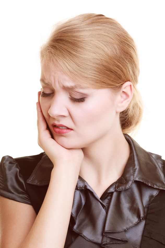 photodune-10695911-toothache-young-woman-suffering-from-tooth-pain-isolated-s.jpg