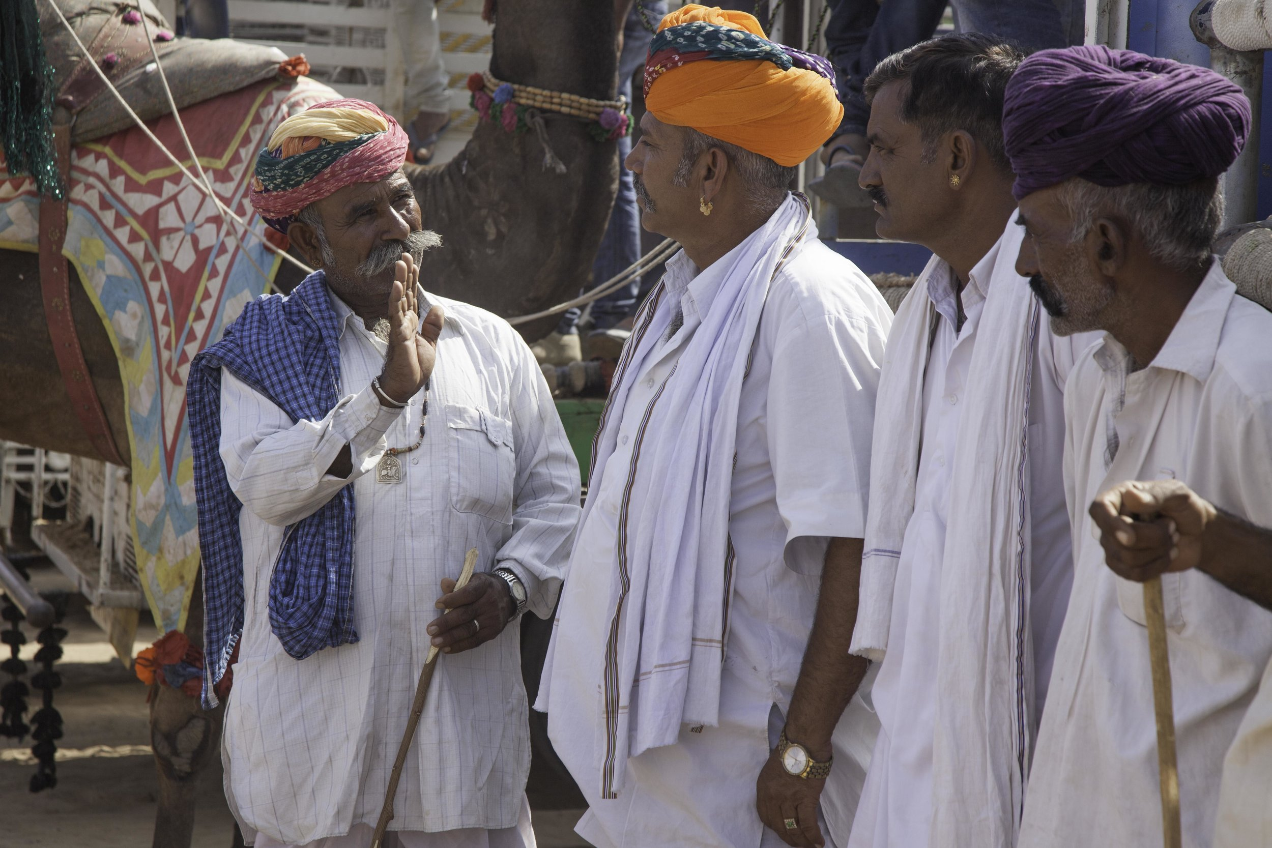 Rajasthani men discussing the festivities.