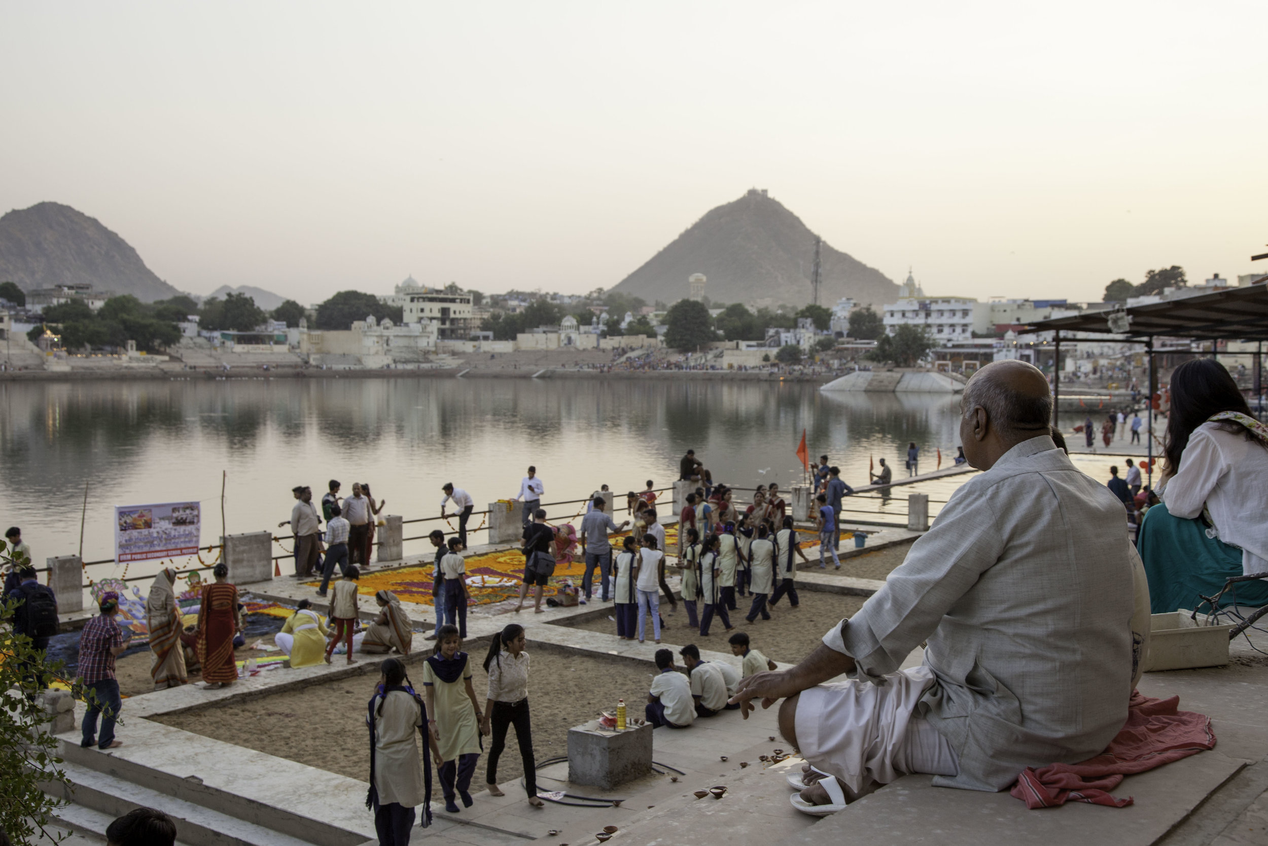 Pilgrims gather around the bathing ghats of Pushkar Lake.