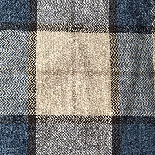 Blue Plaid Herringbone  Style: Checks & Plaids ID: 15684 Color: Blue Retail Price: $18.90 per yard Content: 47.5% Polyester, 52.5% Cotton