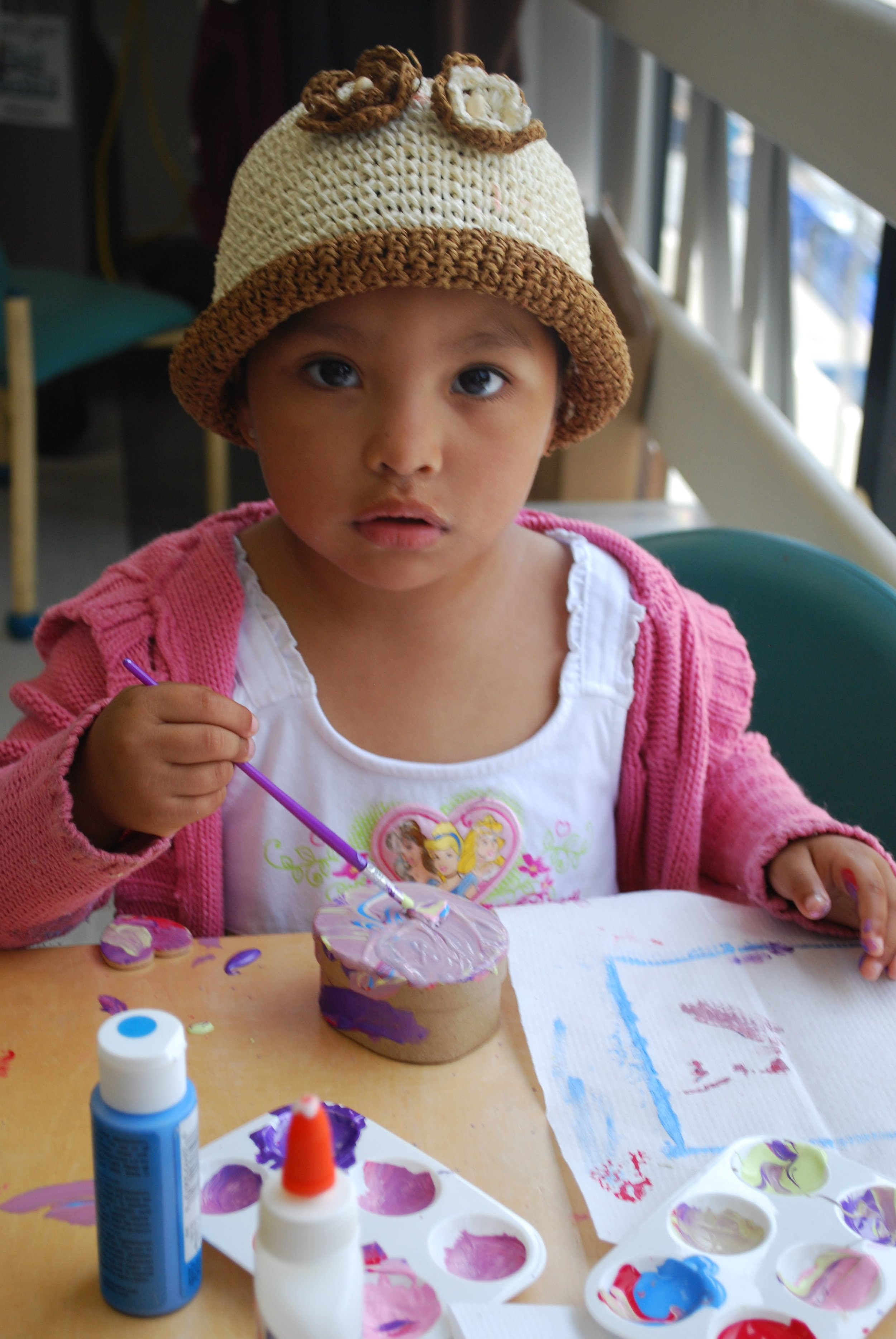Little Girl Painting During a HARK Workshop Photo by Susan Londener