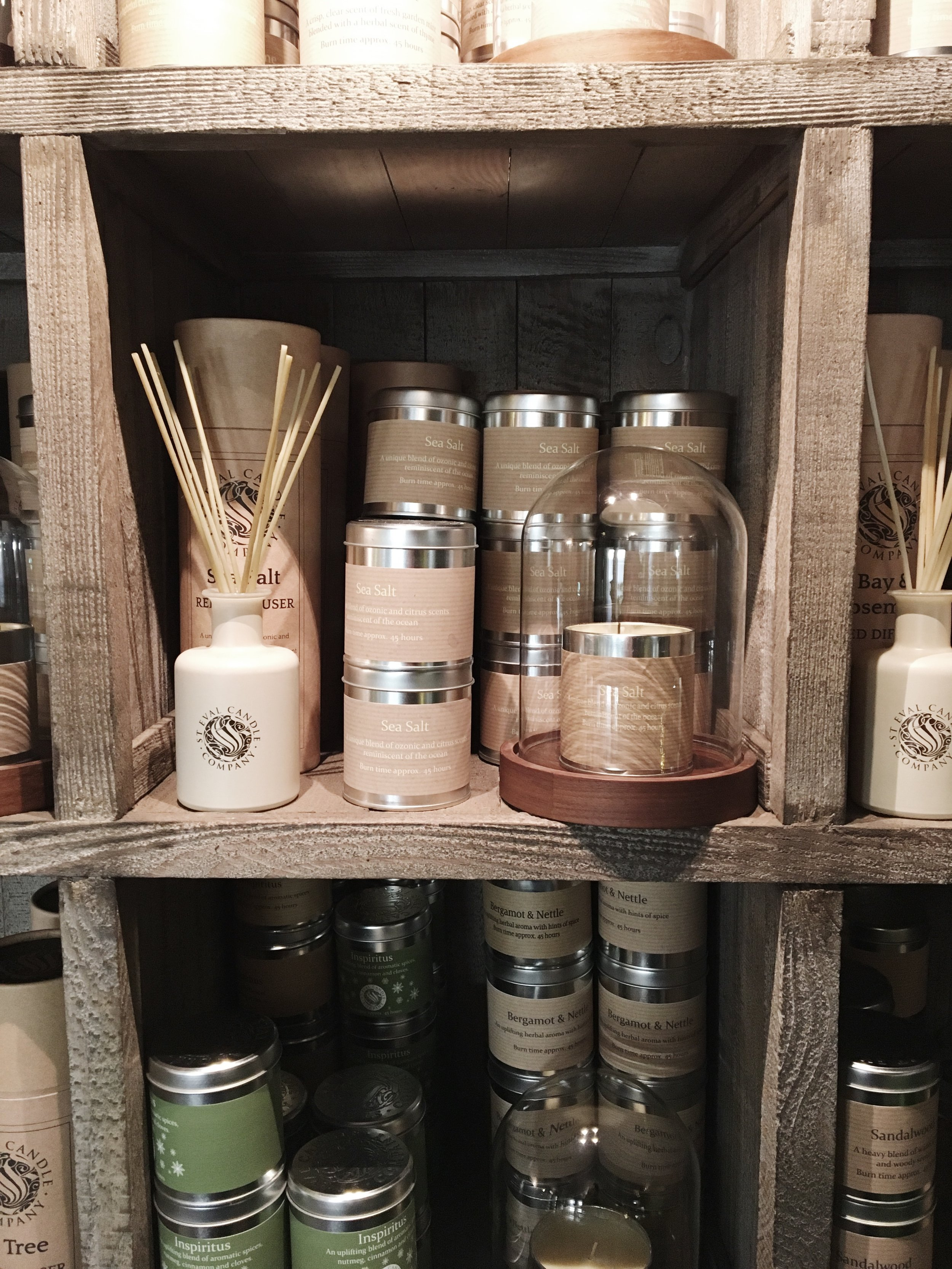 The cosy space is filled with the aroma of earthy candles