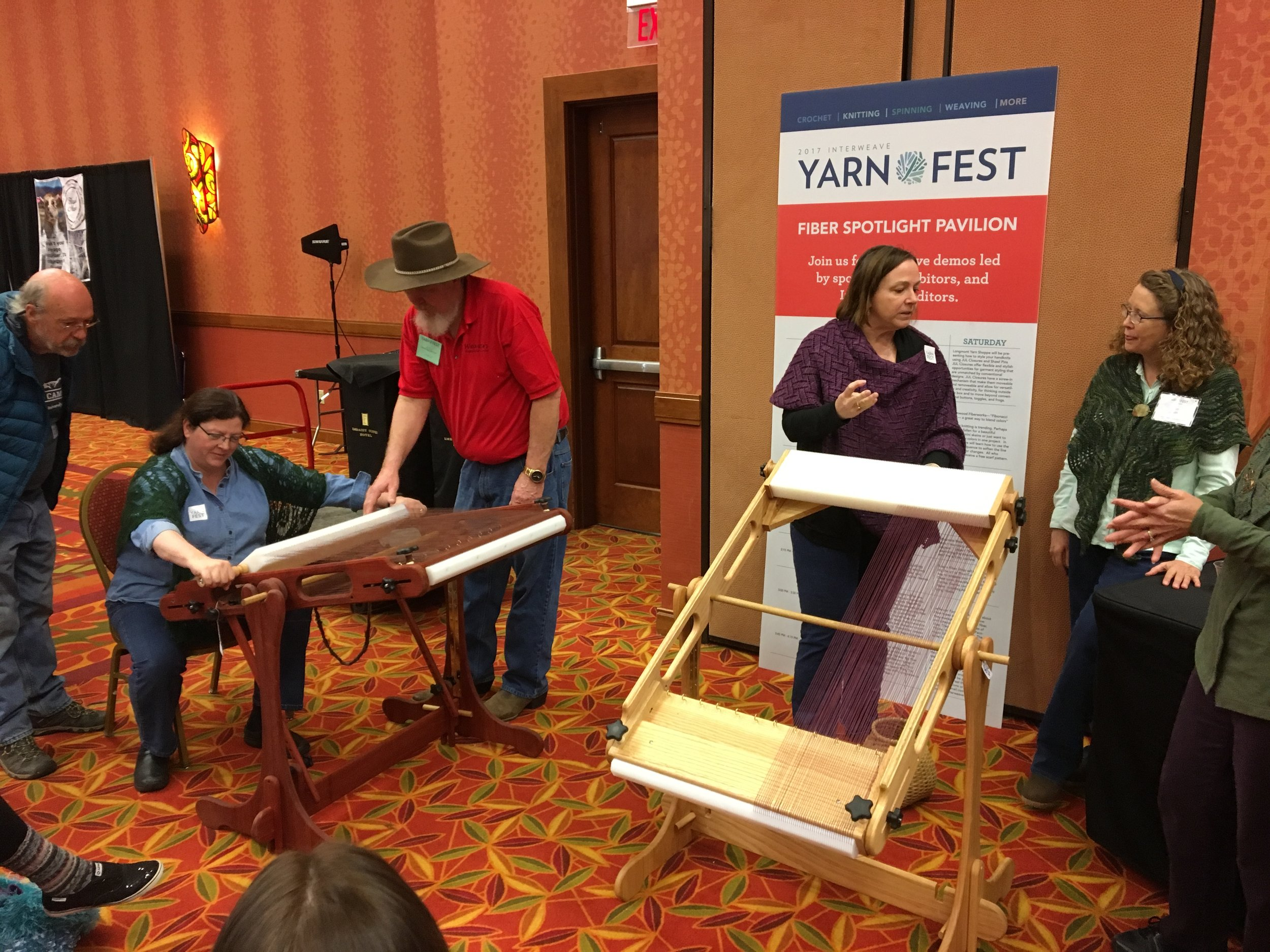 A weaving demonstration on the marketplace floor gave some a chance to try a new craft.