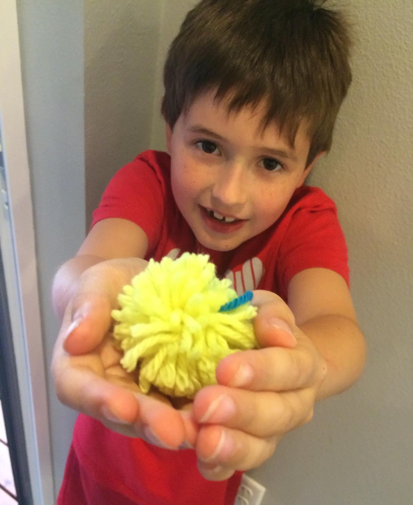 Boys love making pompoms, too.