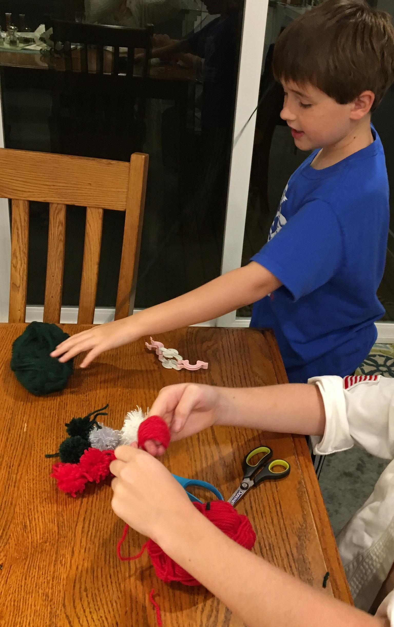 Making pompoms for Christmas gifts.