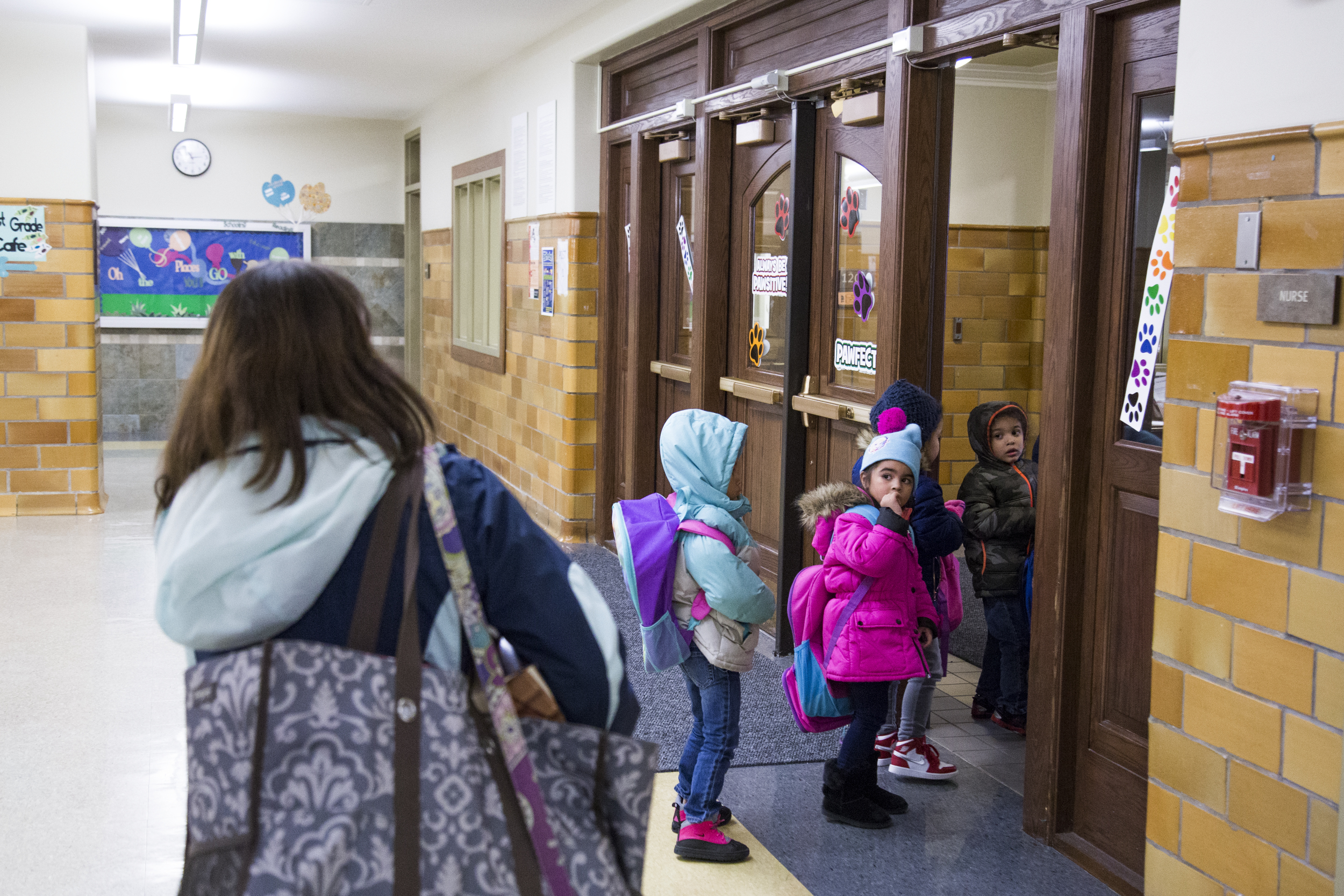 Christine Herne walks the children to the front door to wait for their parents to pick them up.