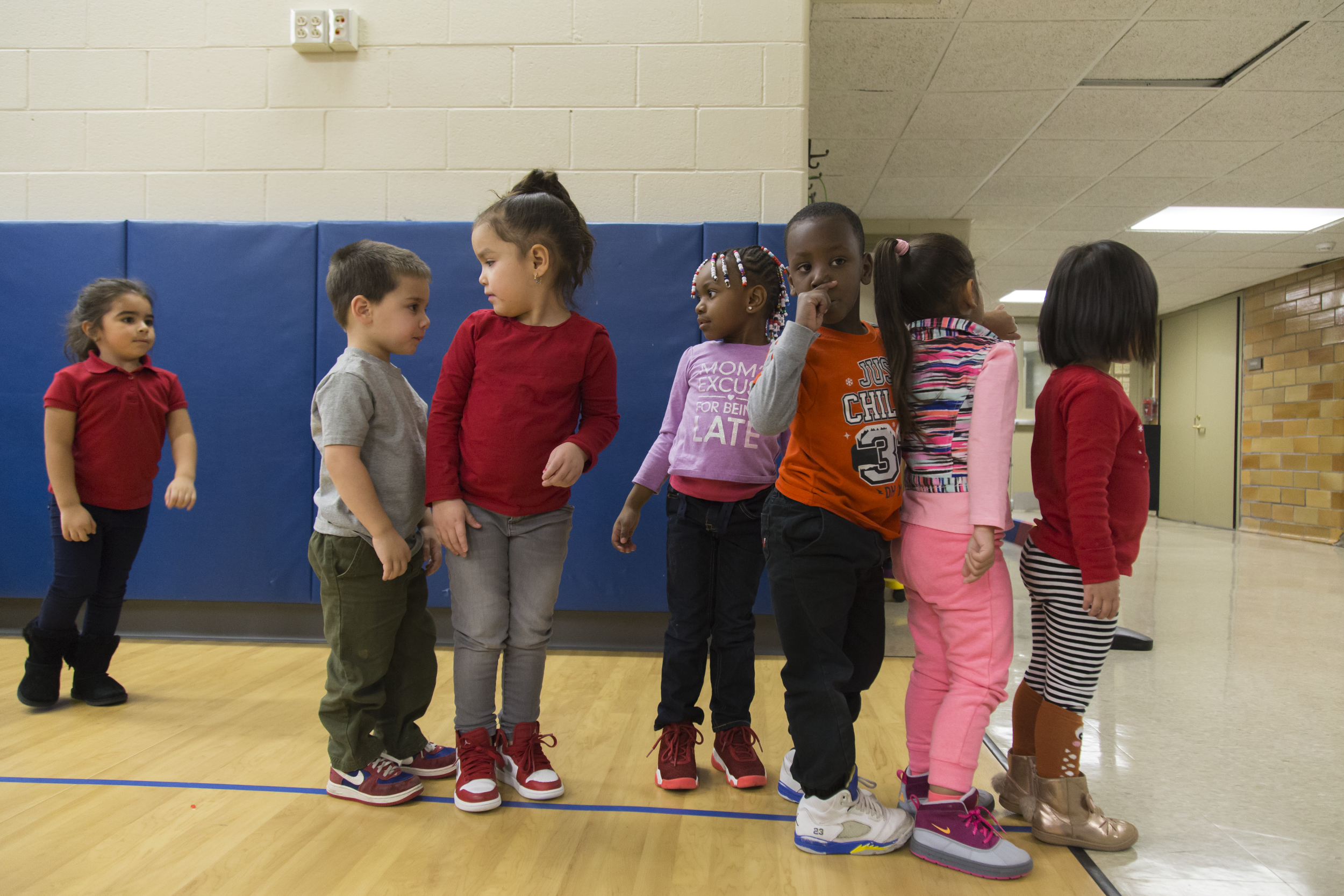 Children of Ms. Herne's preschool class wait in line after before heading back upstairs to their classroom.