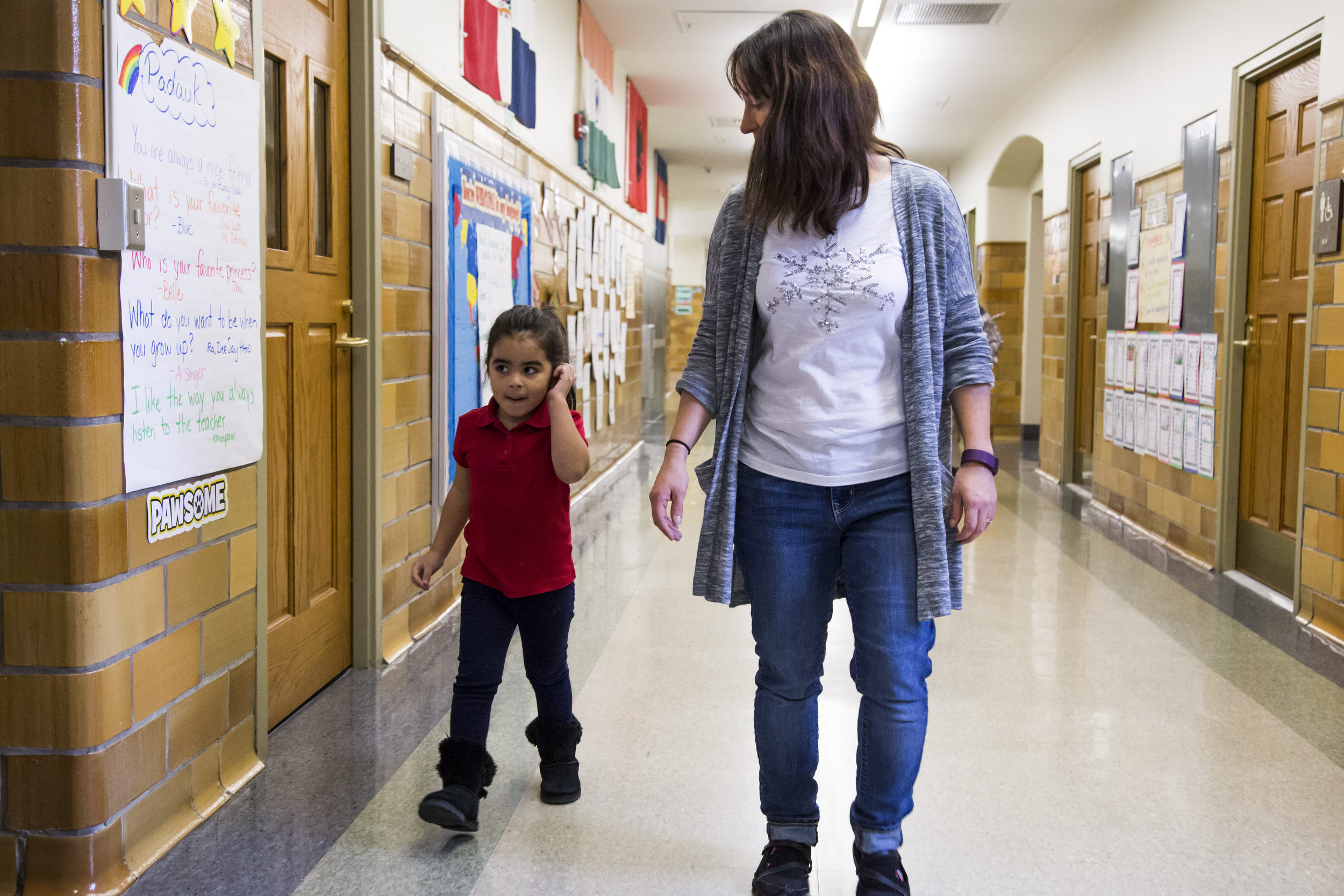 Zoe Vega, left, walks with Christine Herne to the cafeteria.The class prefers to eat in the cafeteria over their own classroom.