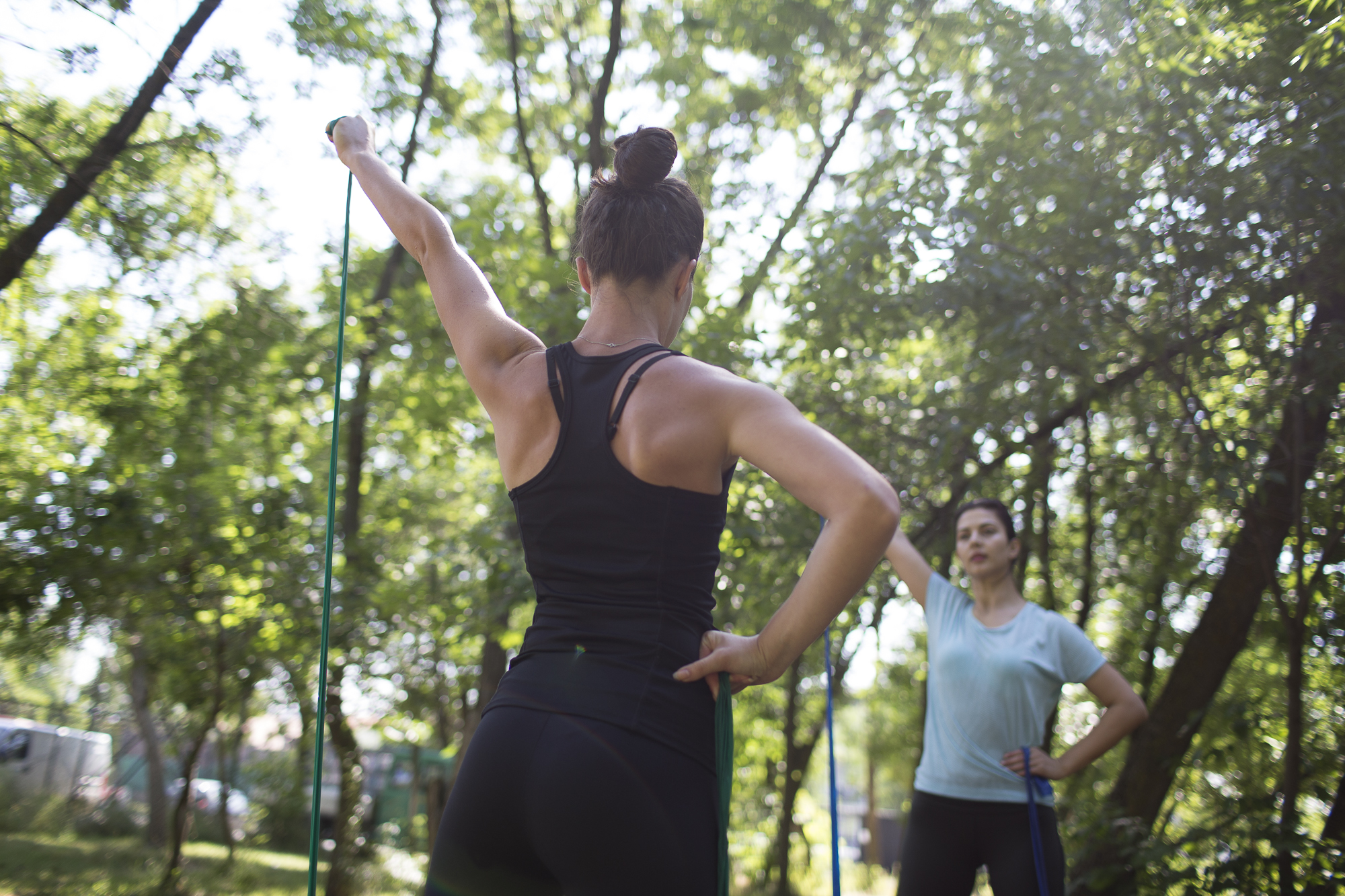 Kaltrina, a personal trainer, and Agnesa excersice in the park.