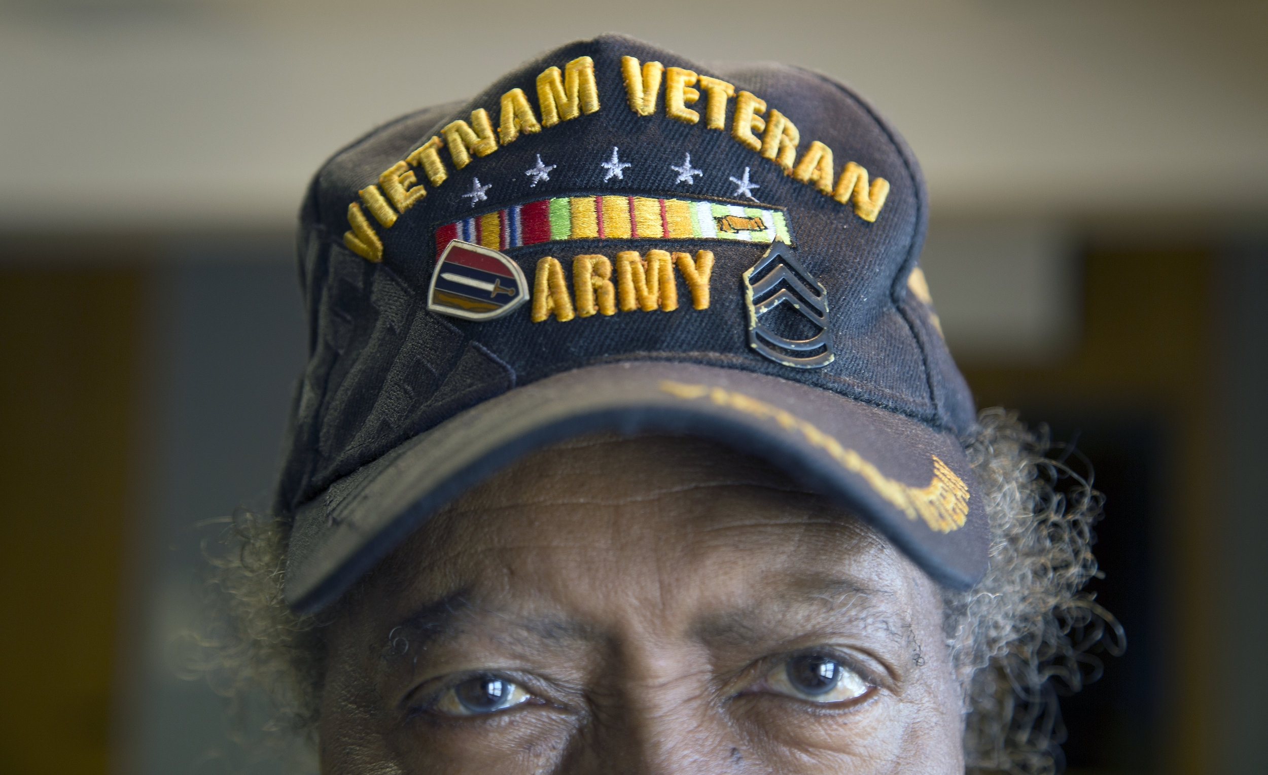 """Juil Robinson Jr. poses for a portrait on Aug. 22, 2017. Robinson was drafted to serve in the U.S. Army during the Vietnam War. """"The country called, I got drafted. They said, 'Come,' so I went."""" (Emily Hunt/WXXI)"""