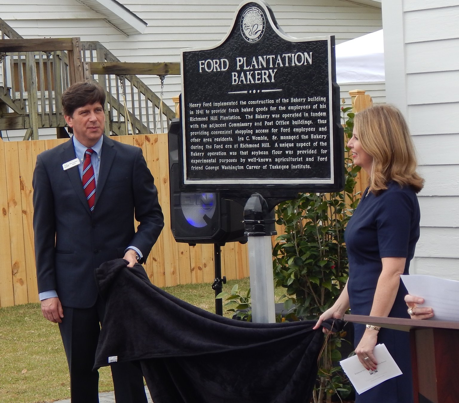 Mayor Russ Carpenter (left) and Christy Sherman of the CVB unveil the historical marker. Photo by Mark Swendra.