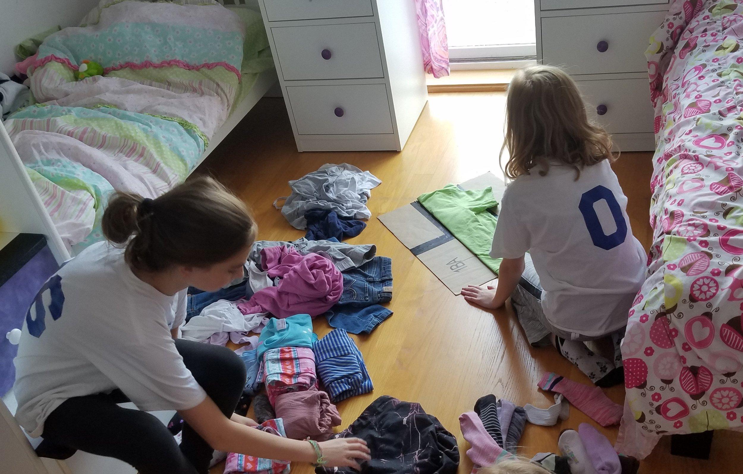 My girls using their homemade folding board.