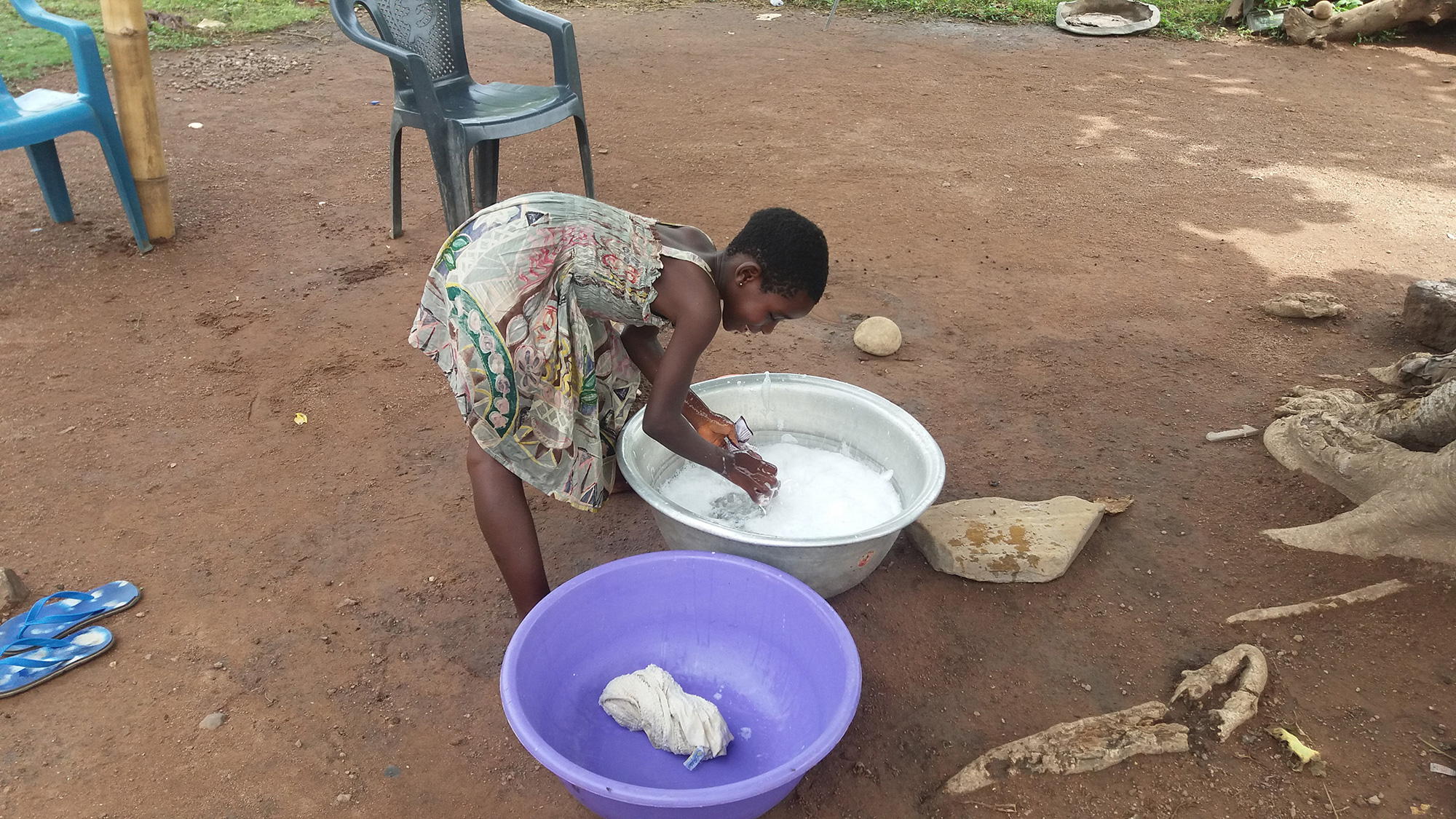 Girls usually help their parents by hand washing clothes during the weekends in sub-Saharan African countries. Electricity and washing machines are extremely rare.