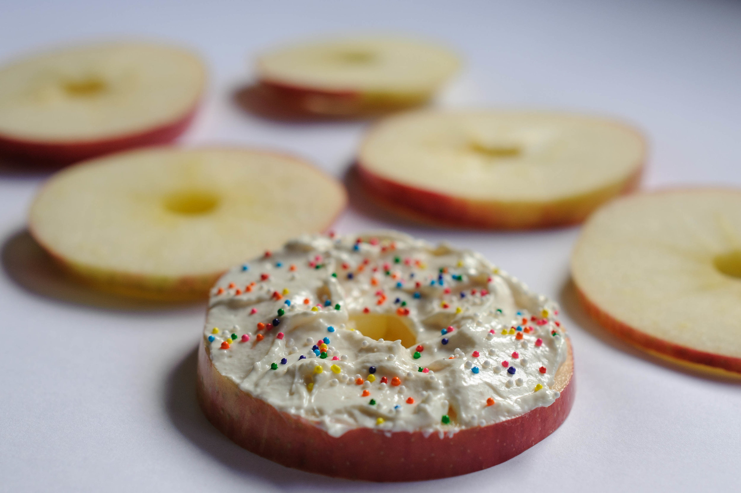 White cream cheese frosted apple slice