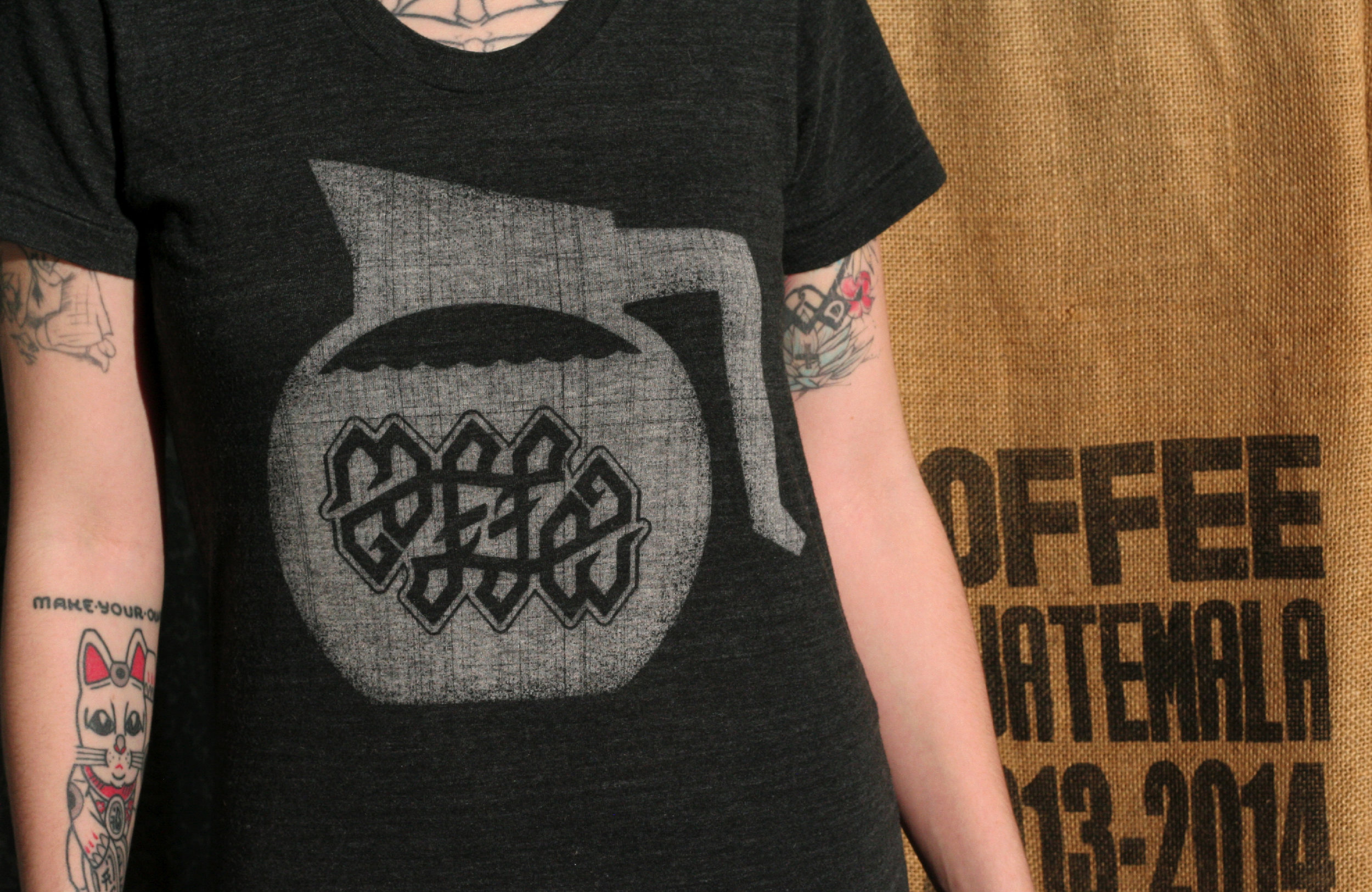 Coffee ambigram symbol was designed by Neuer Geist for Cotton Bureau. The design earned enough pledges to be produced and sold.