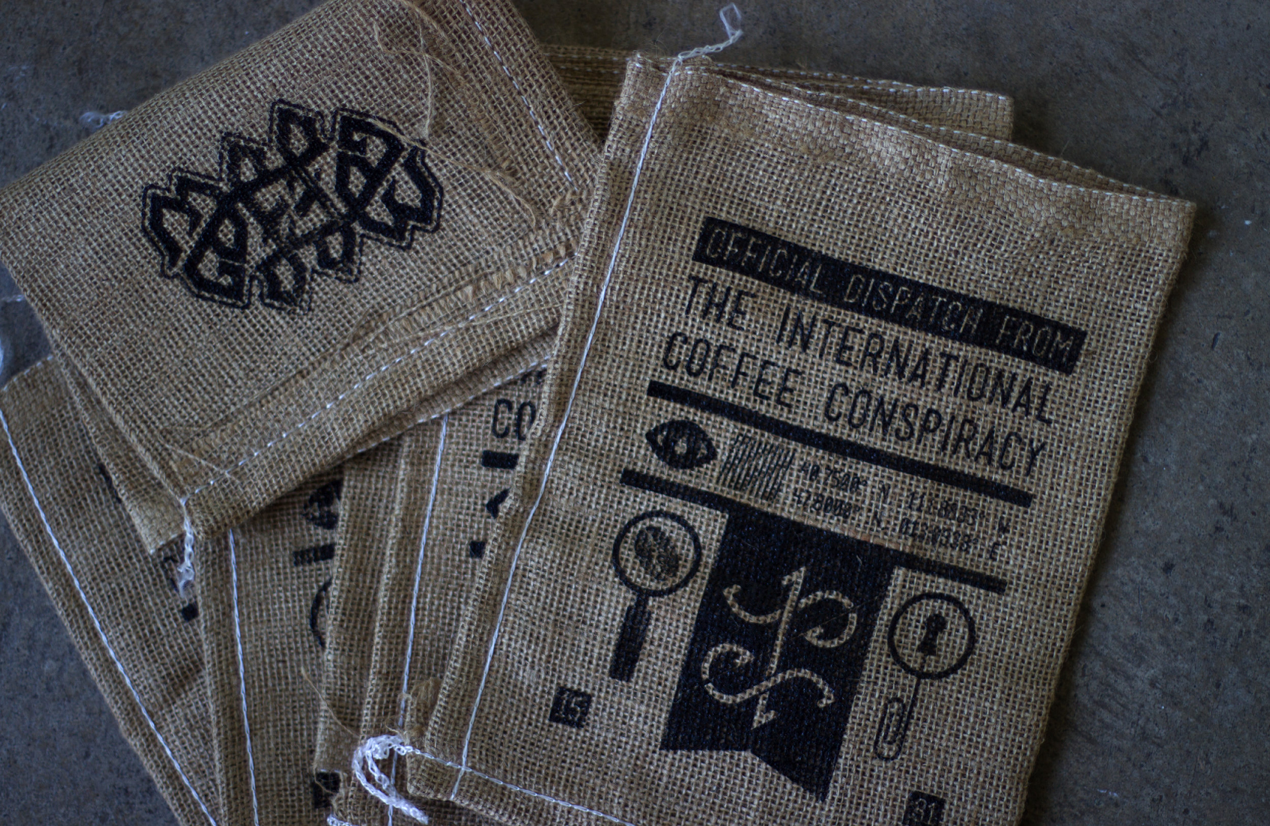 Hand-printed burlap bags produced for zine packaging.
