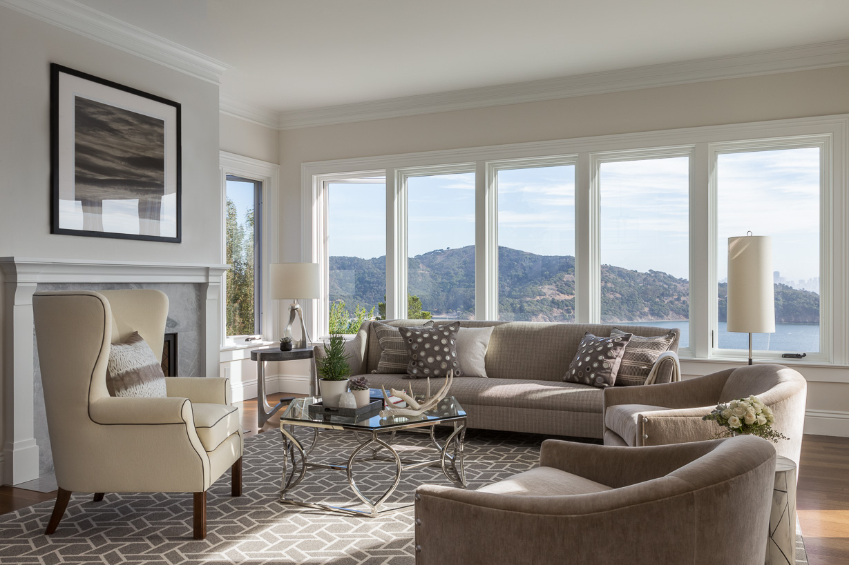 A selection of understated furnishings in neutral hues allows the bay views to remain the focal point in the family room. Throw pillows in Glant and John Robshaw fabrics accent the sofa and leather-trimmed wingback chair. The cocktail table is by Bernhardt.