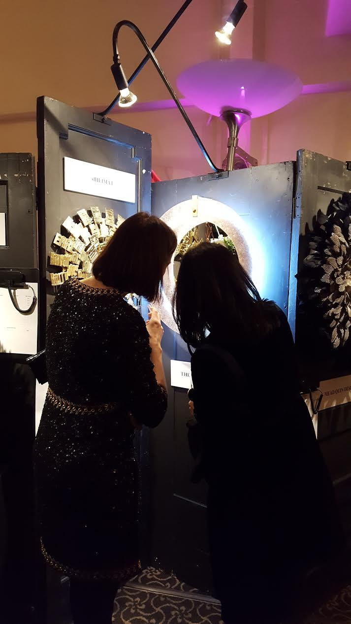 Guests admire The Wiseman Group's wreath