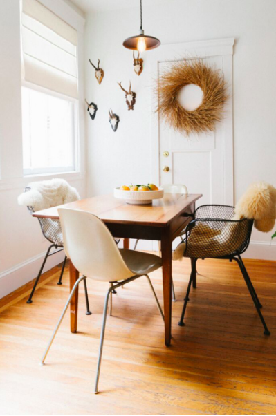 Warm eclectic dining room by  Heidi Caillier Design .