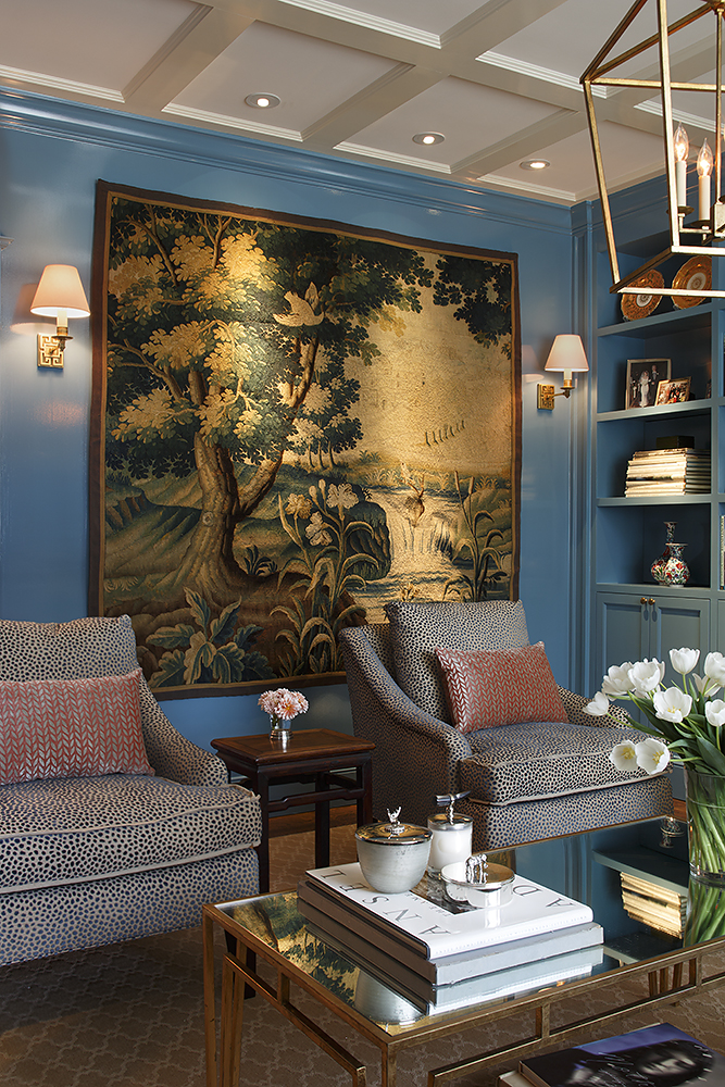 Anne Lowengart Interiors  developed this living room's vibrant navy and rouge-de-fer color palette from the clients' circa 1600s Flemish tapestry.