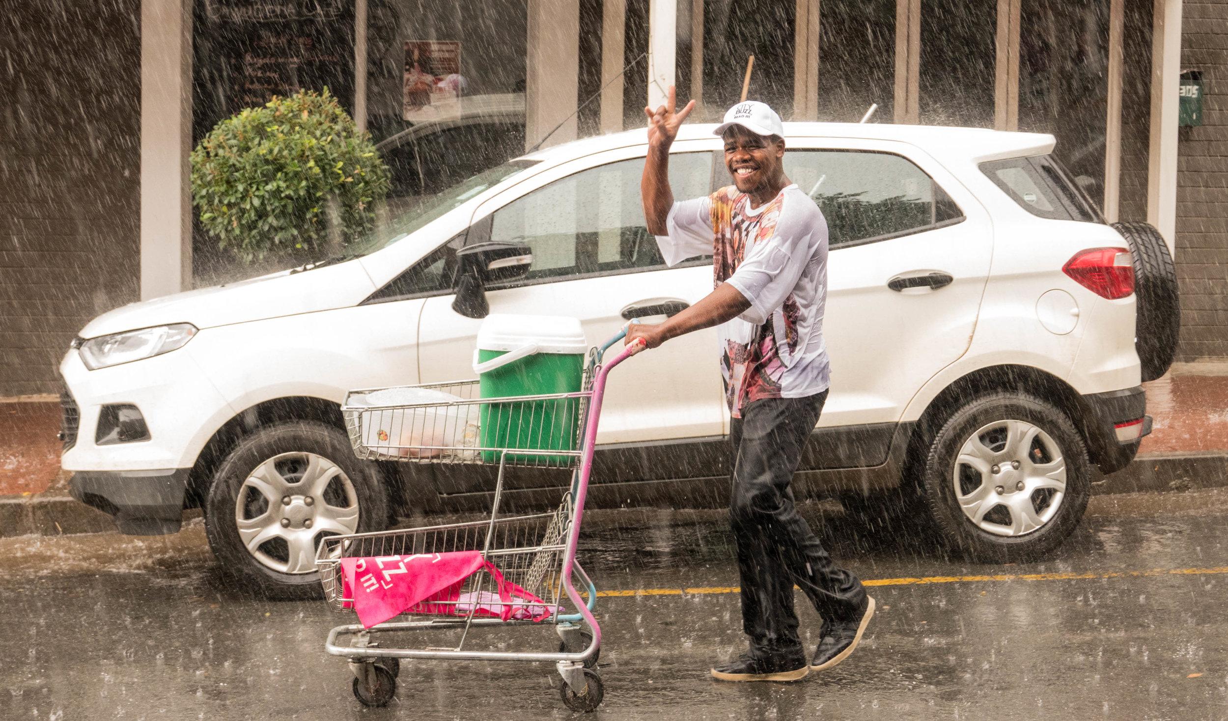 smiling dude in the rain