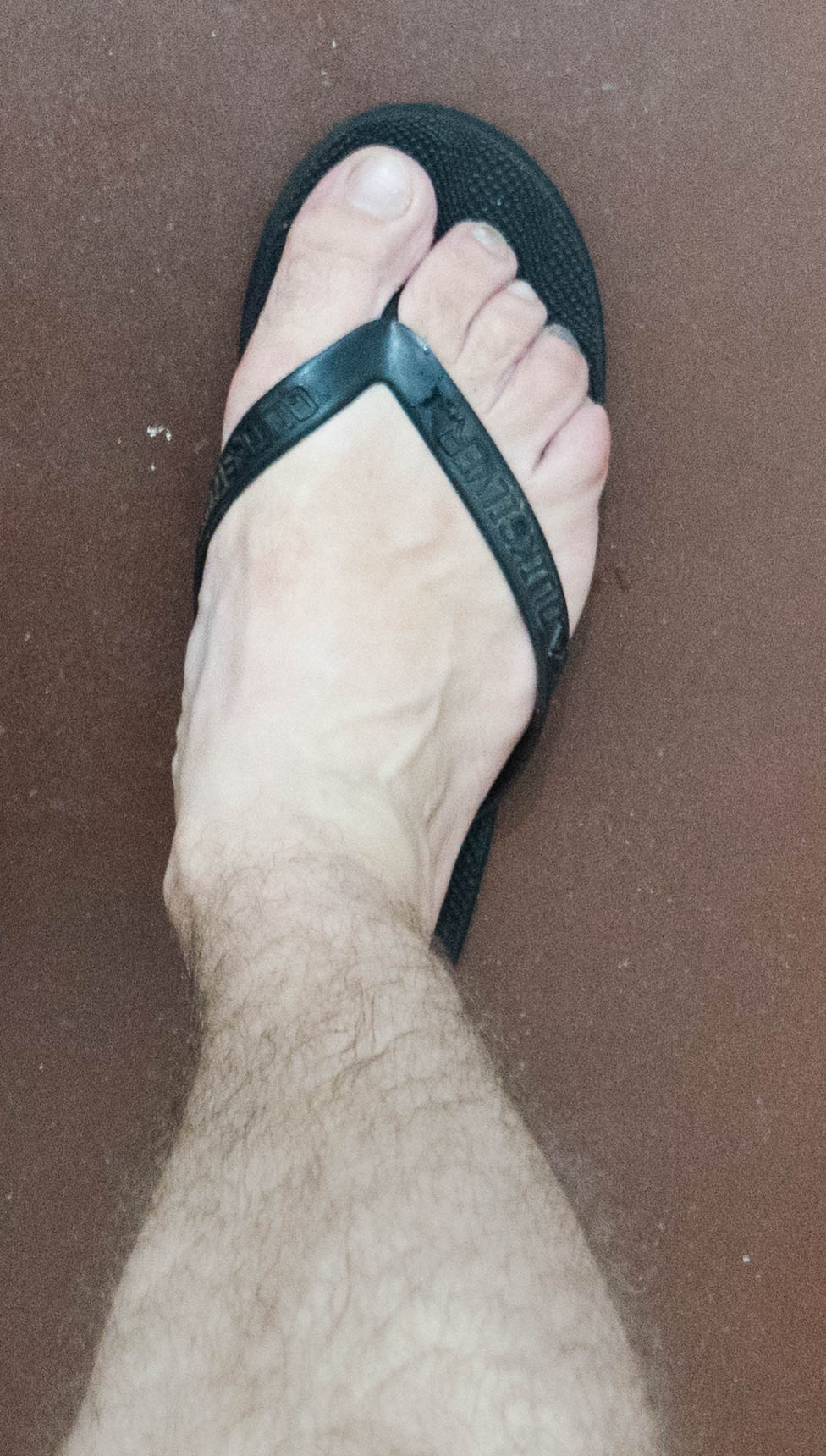right foot with flip flop (1 of 1).jpg