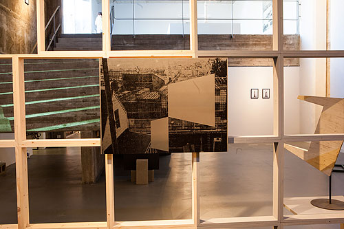 Jonathan Runcio, foreground; Amy M. Ho, staircase