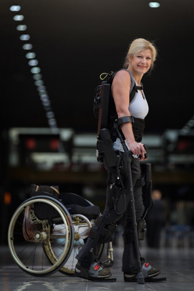 Amanda Boxtel, Executive Director for  Bridging Bionics Foundation , walks in an Ekso - a bionic exoskeleton suit from manufacturer Ekso Bionics. Funds raised from race2walk2016 will enable Bridging Bionics Foundation to purchase a second exoskeleton suit from a different manufacturer for their local program to enable individuals with mobility impairments to regain mobility, stand up and walk.