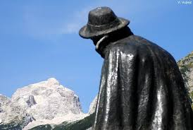 A Statue of Julius Kugy gazes at the Mountains