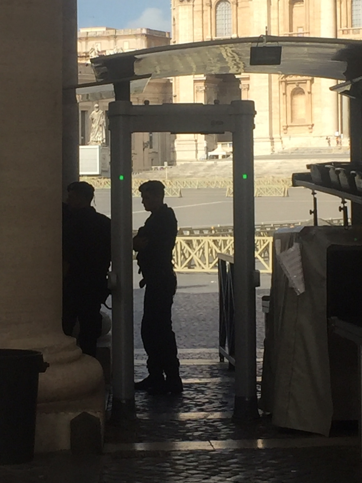 Guards await the screening of the crowds at the Vatican.