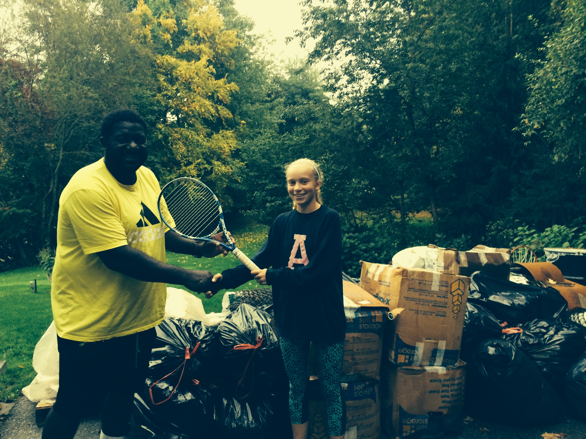 Jennifer Riester meeting Joseph Oyebog in CT. from the Oyebog tennis academy in Cameroon. This TWOB young ambassador has collected hundreds of rackets, shoes and clothes!