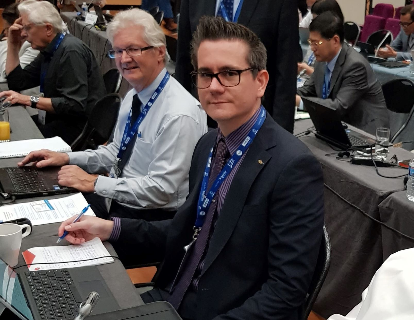 Justin Gavranich (right), lead Australian delegate at IECEx meeting in Cannes, France