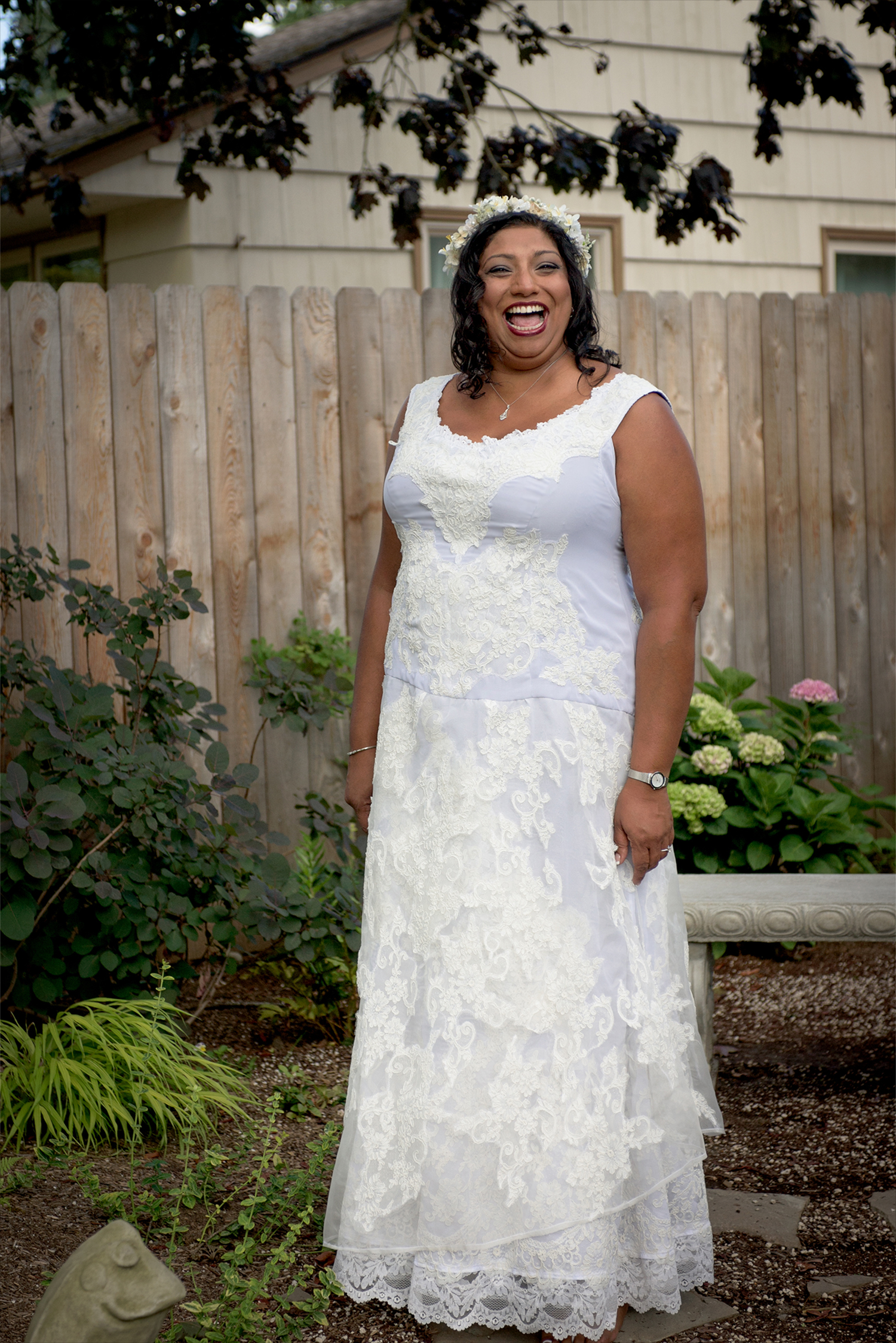 Custom lace wedding dress made from doilies cut from woven lace yardage and appliqued to 2 layers of a frosty chiffon
