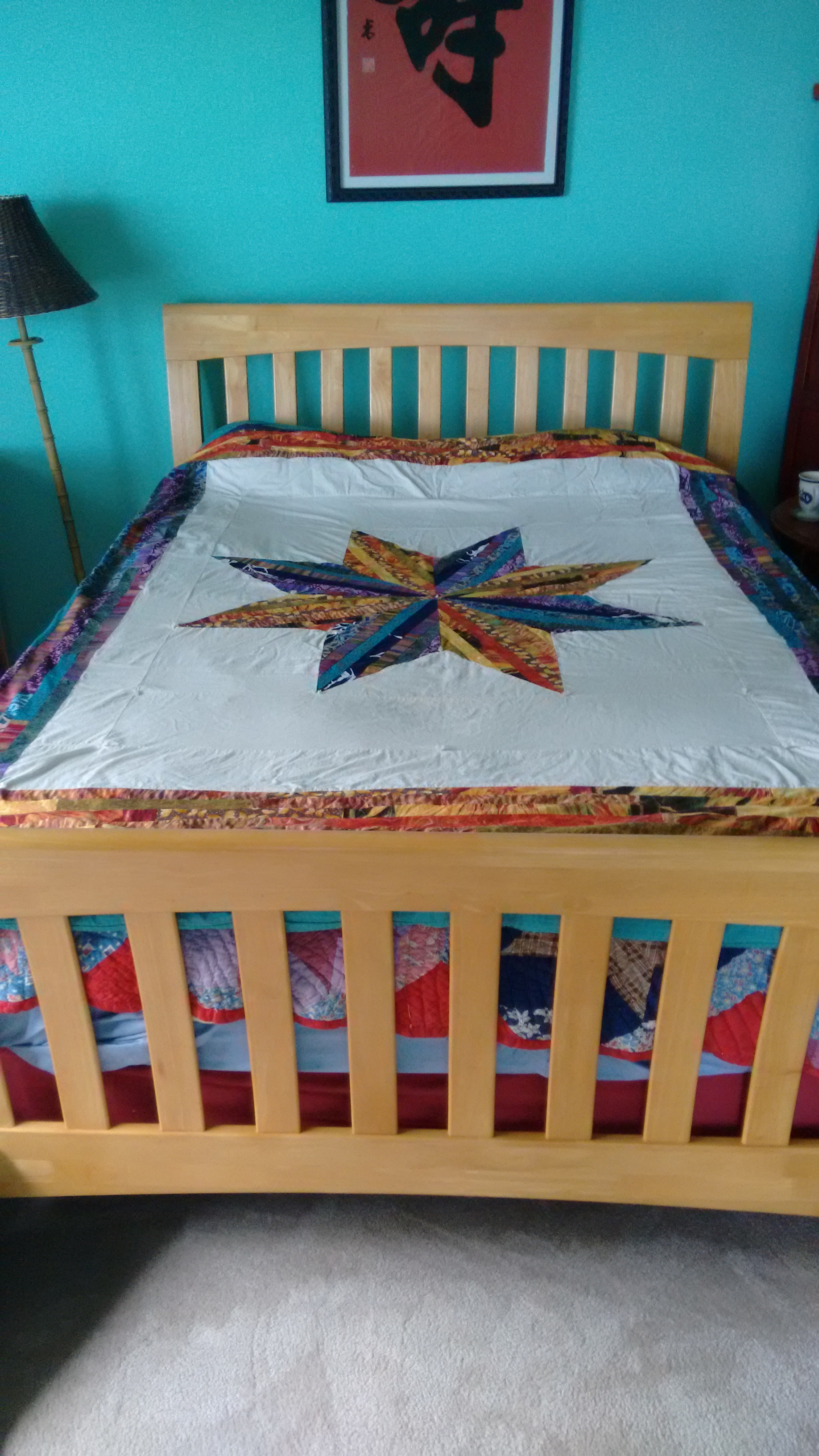"My first piecework quilt using pre-printed fabric, for my Mother. ""Lemoyne Star"" traditional quilt design."