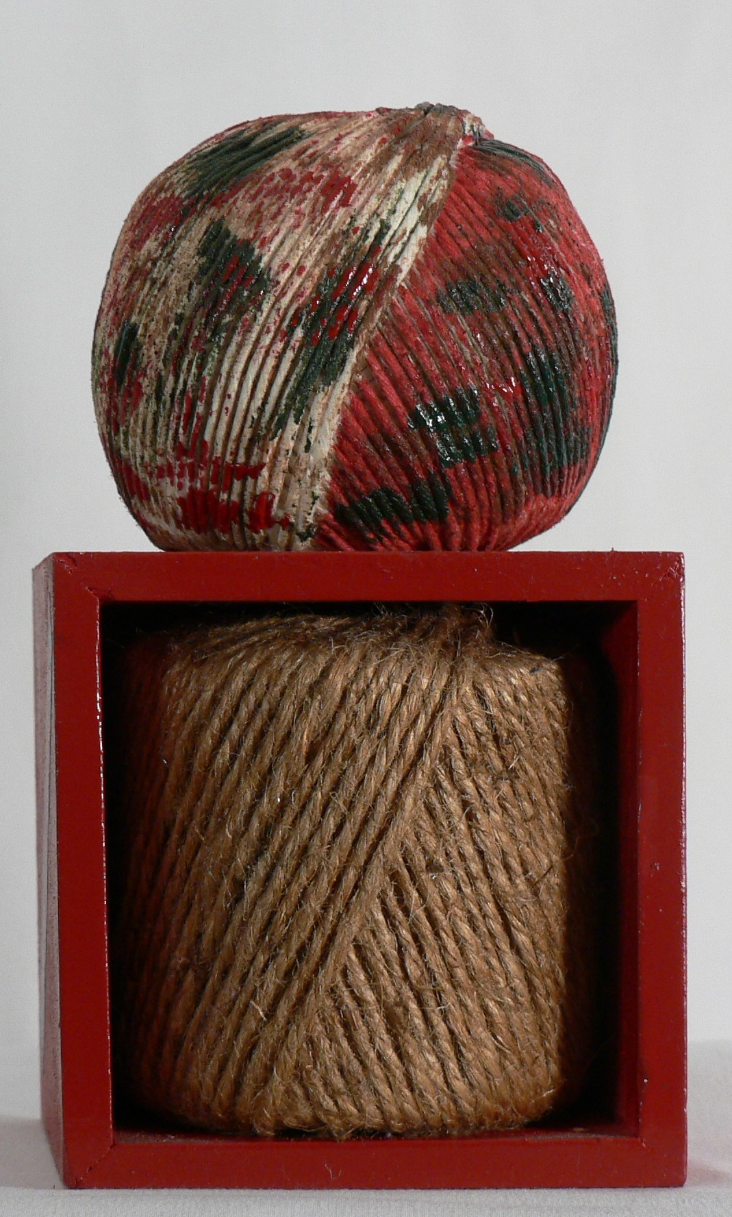 "String Theory - ""I've cried over string arrangements."" -- Janelle Manae, American singerMaterials: Balls of twine; wood box; acrylic paint; paper. Dimensions: 6.5""H x 3.5""W x 3.5""D. Created: March 2018.Status: For Sale ($150)."