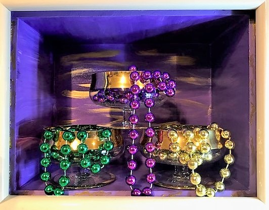 """New Orleans - """"America has only three cities: New York, San Francisco, and New Orleans. Everywhere else is Cleveland."""" -- Tennessee WilliamsMaterials: Purpose built wood box; wood frame; acrylic paint; glass goblets; paper; Mardi Gras plastic beads. Dimensions: 9""""H x 11.5""""W x 7""""D. Created: June 2018.Status: For Sale ($100)"""
