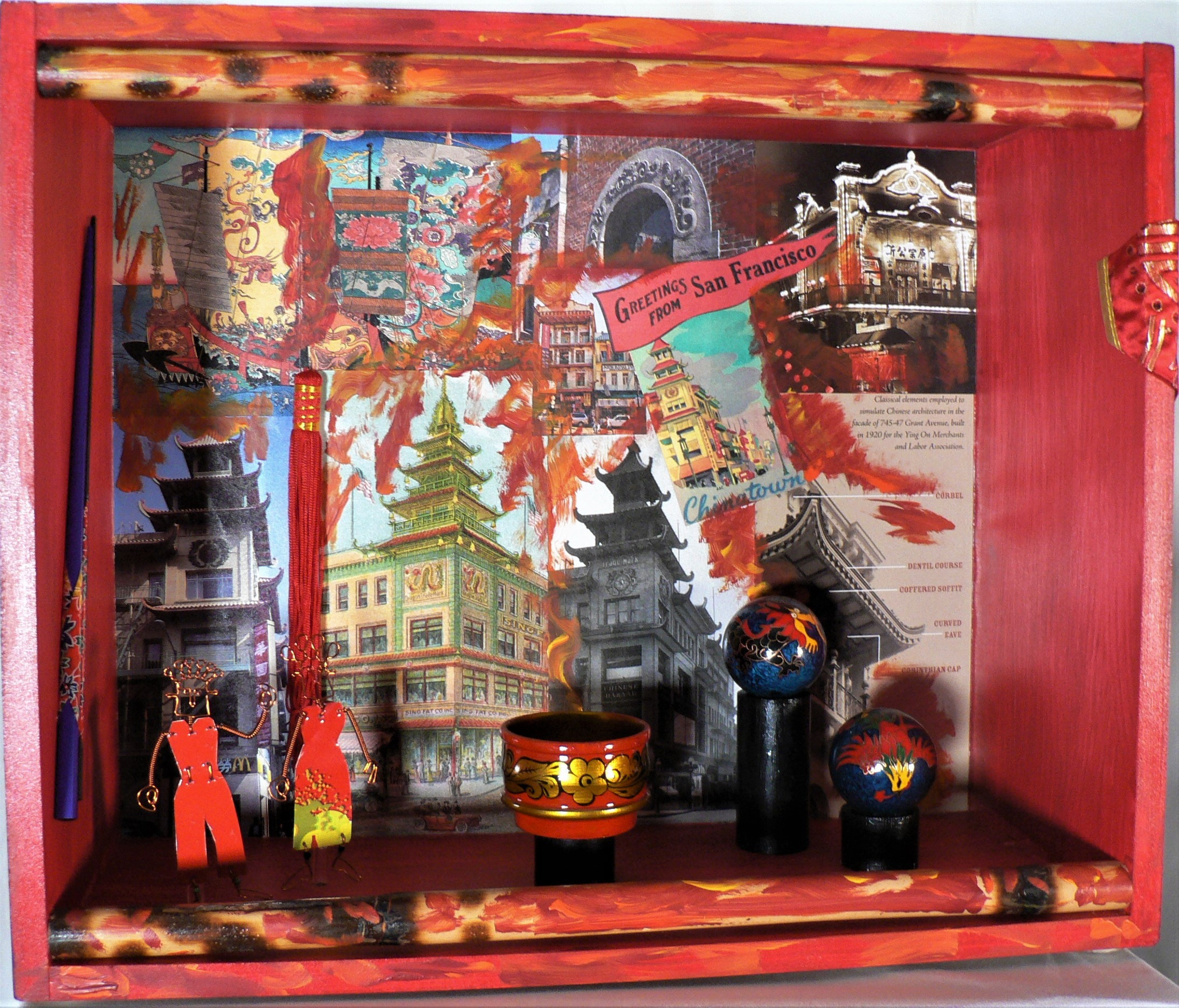 "Clearly Chinatown - ""I grew up in an immigrant neighborhood. We just knew the rule was you're going to have to work twice as hard."" --- Lin-Manuel Miranda (American composer)Materials: Purpose-built wood box; bamboo martial arts sticks; recycled metal figures; Chinese doll's clothes; postage stamps; lacquered bowl lid; tassel; paper image from a SF poster; paper images from SF Chinatown: A Guide to Its History and Architecture; Chinese metal baoding balls; acrylic paint; lacquered bowl; paper. Dimensions: 14""H x 17""W x 7""D. Created: July 2018.Status: For Sale ($200)"
