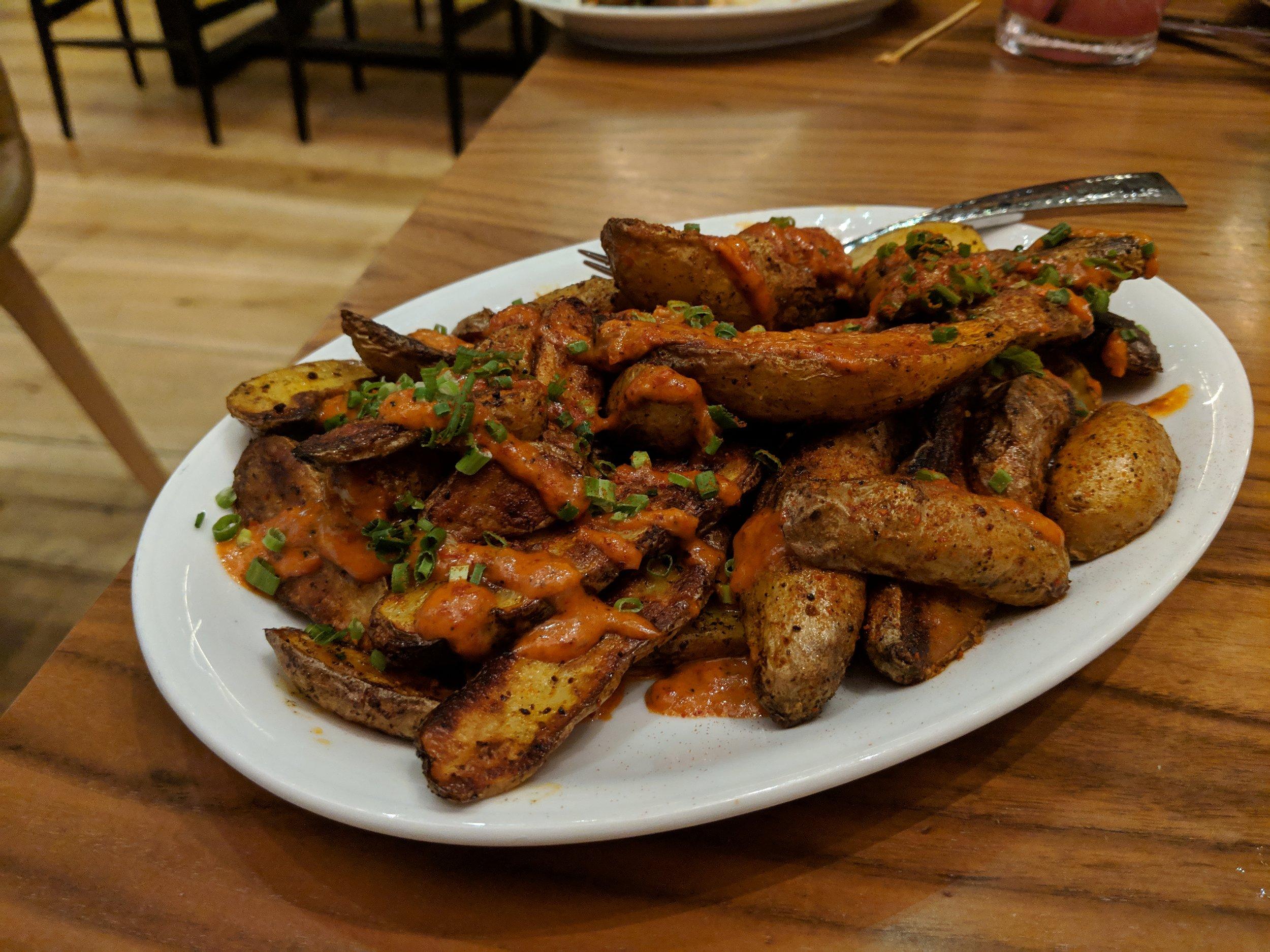 Patatas bravas (fingerling potatoes in a tomato-based sauce)