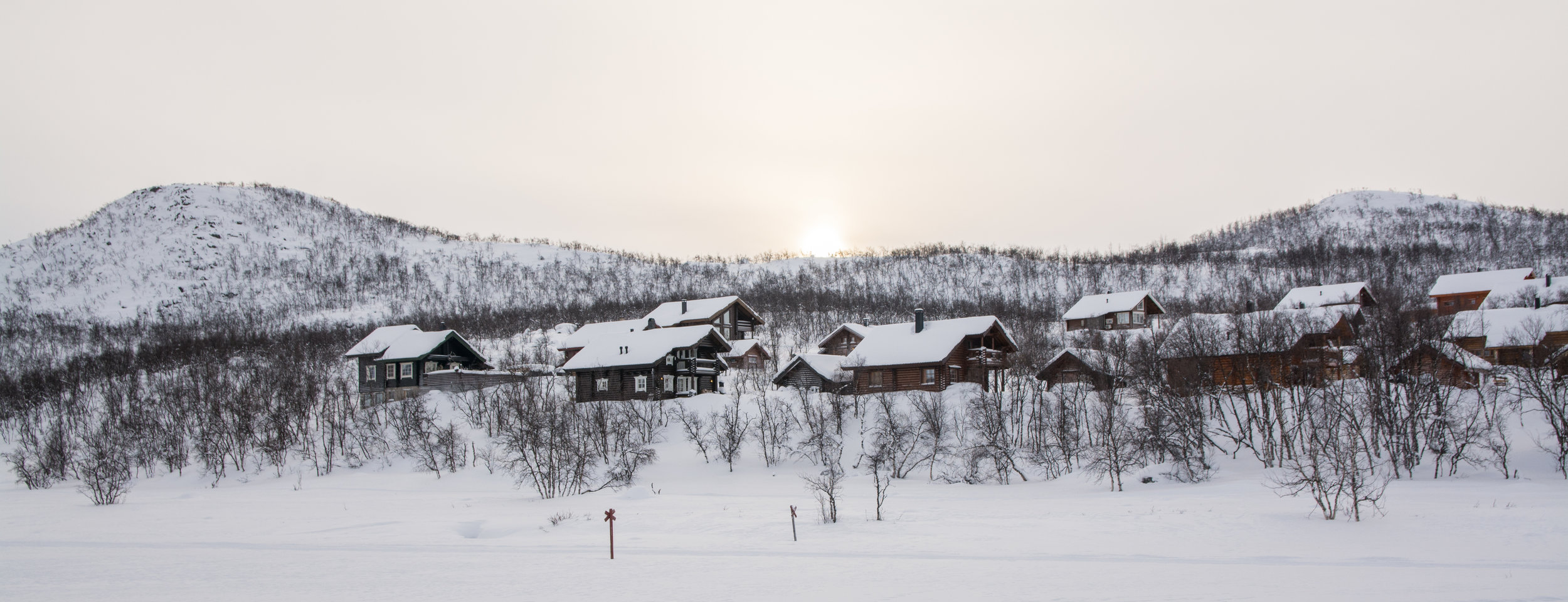 A row of houses along Lake Kilpisjärvi.