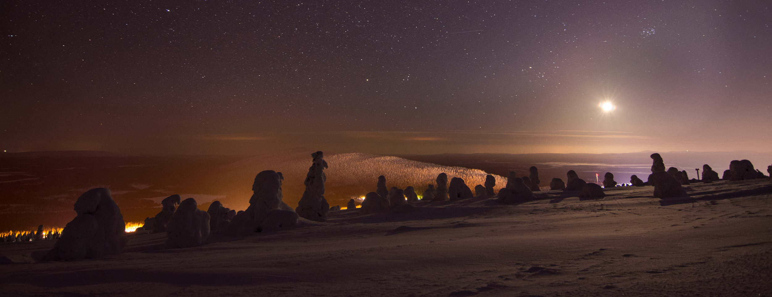 A full moon combined with light pollution from the ski hill makes for some dramatic lighting.