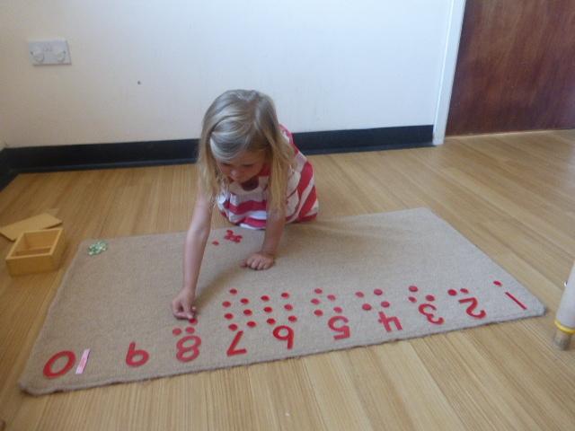 BT girl counting on floor.JPG