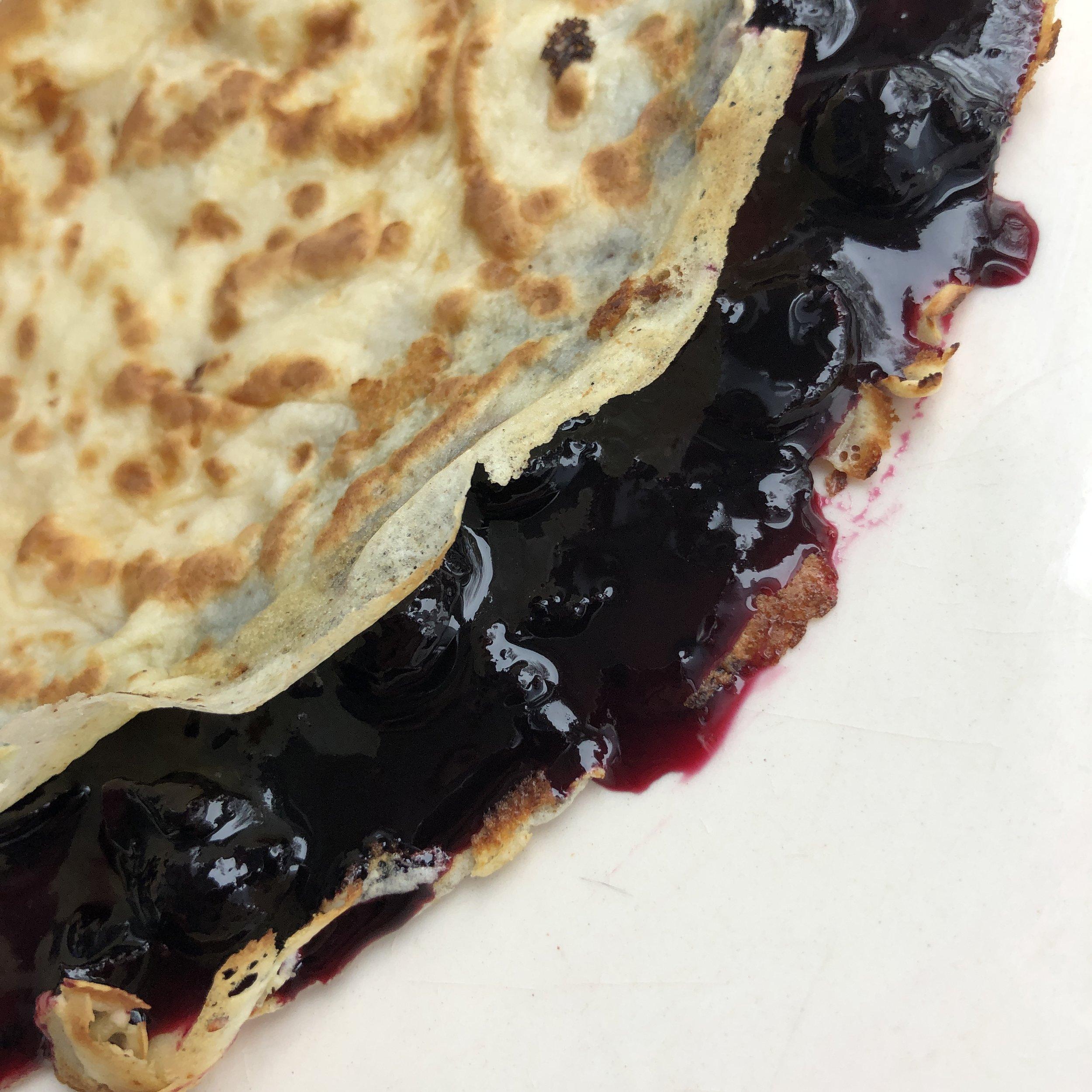 pancake with blackcurrant preserve